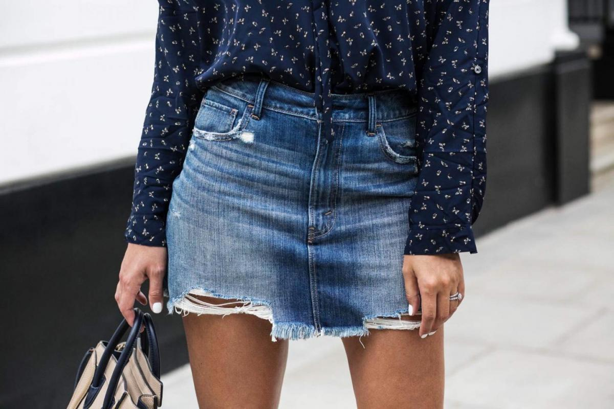 distressed ripped frayed denim mini skirt, white nails, navy blue ditsy butterfly print blouse shirt