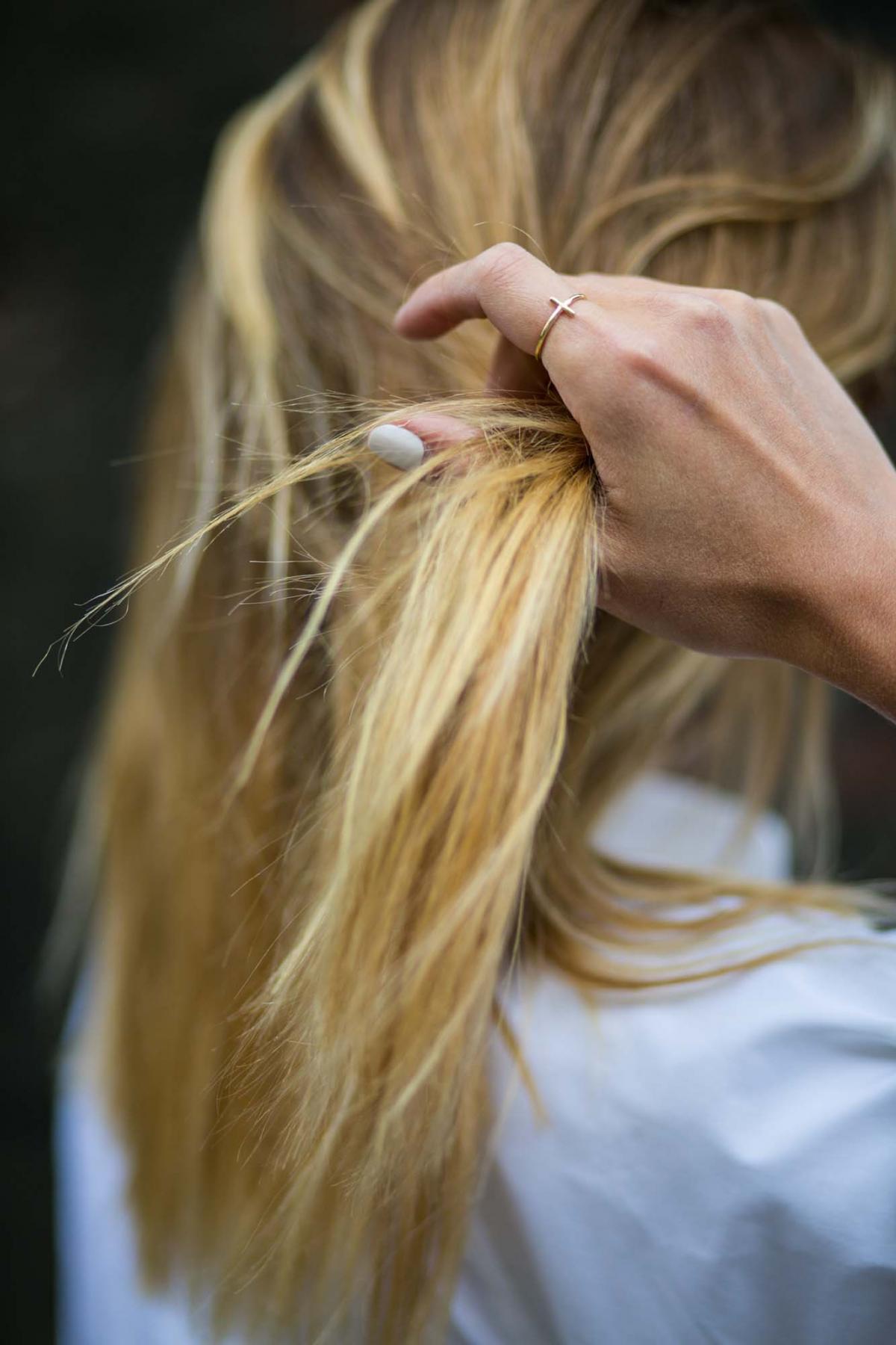 gold cross ring, blonde balayge hair