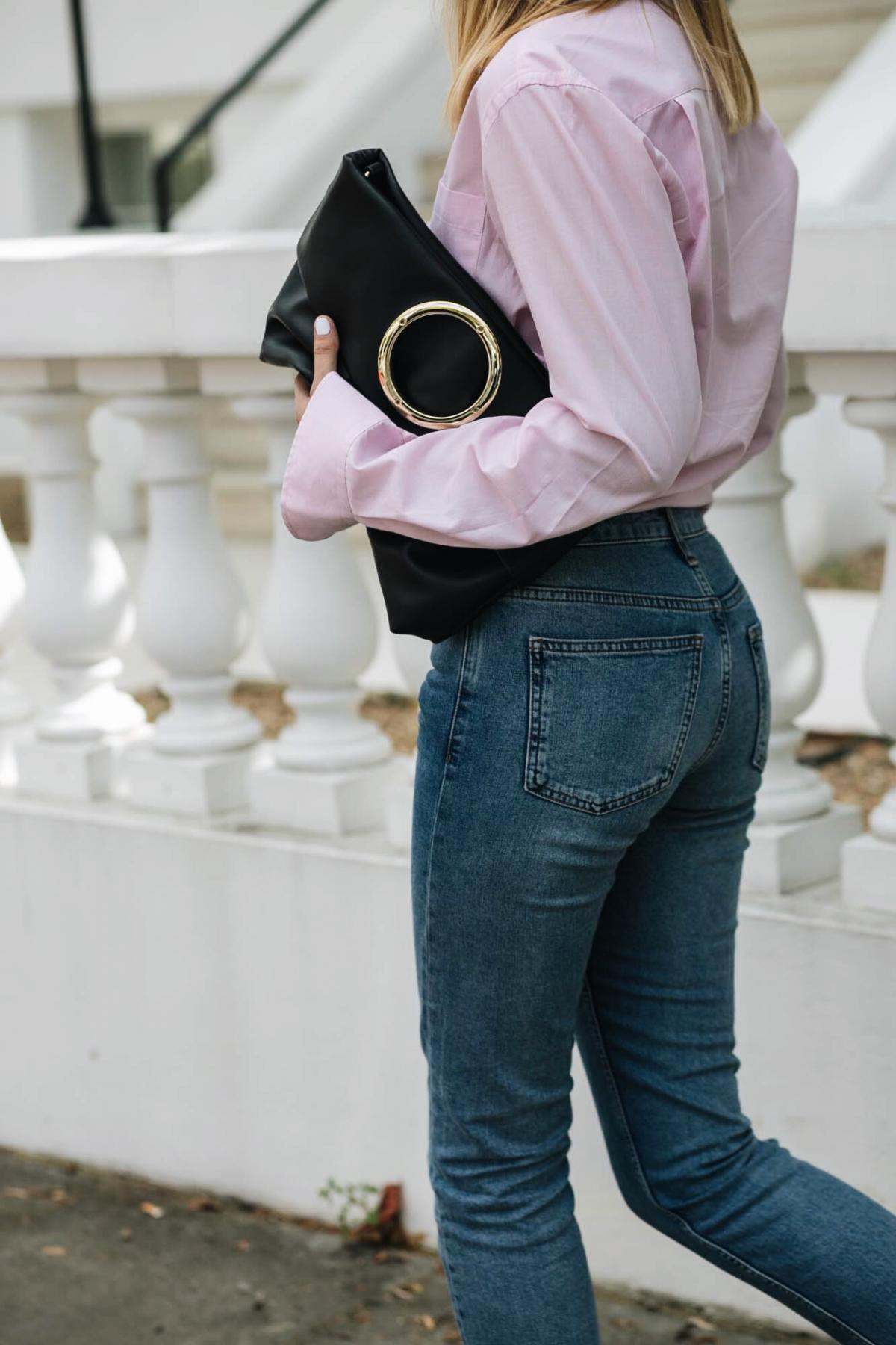 pink shirt, ring detail eyelet black leather clutch bag, straight leg topshop jeans, street style