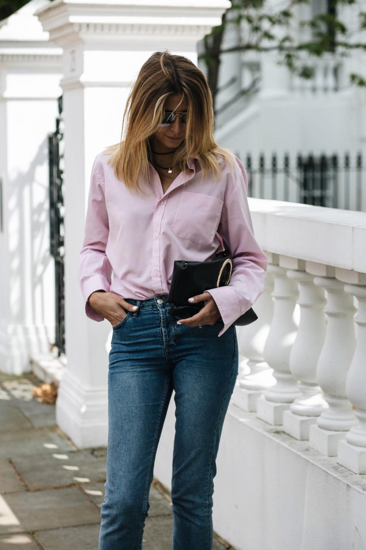 pink shirt, street style trend, straight leg jeans, ring detail clutch bag