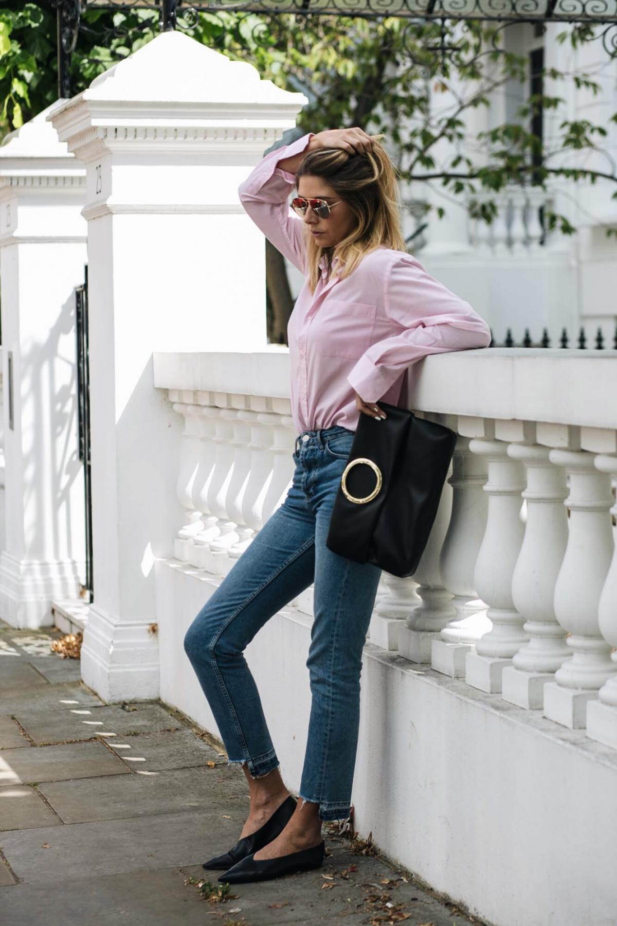 how to wear pink, street style, mens pink shirt, straight leg stepped hem jeans, gold ring detail black leather clutch bag, black pointed flats, babouche flats, casual outfit