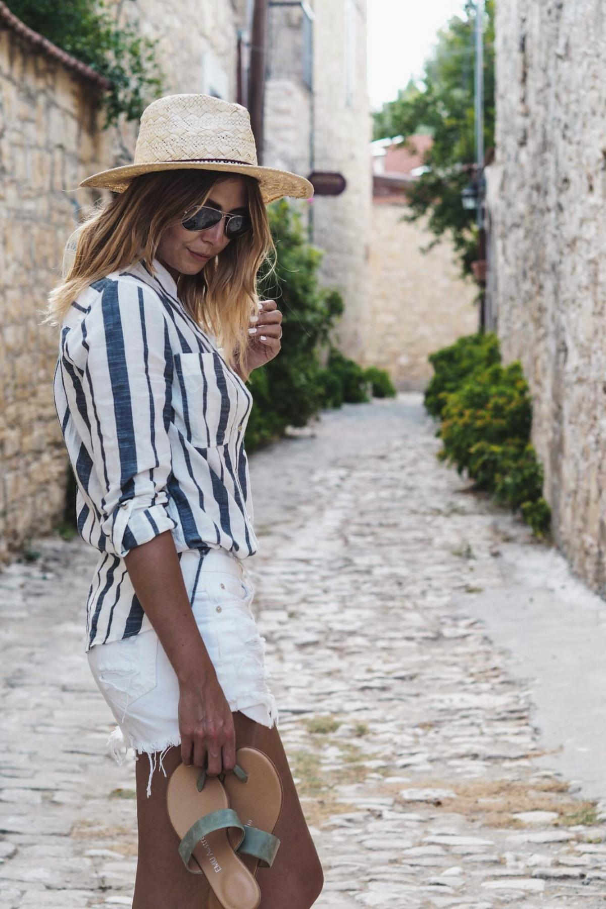 travel outfit, vacation, stripe shirt, white denim short, sandals, straw hat