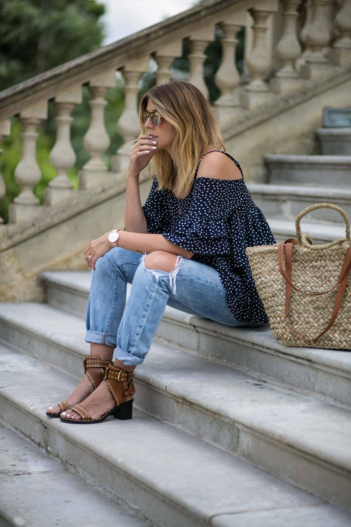 navy polka dot top, boyfriend jeans, levis, straw wicker beach bag, Isabel Marant tan sandals, summer outfit