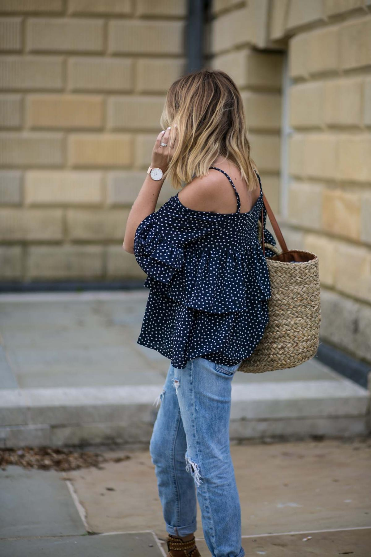 navy polka dot cold shoulder top, levis boyfriend jeans, straw wicker beach bag tote, summer outfit, summer style