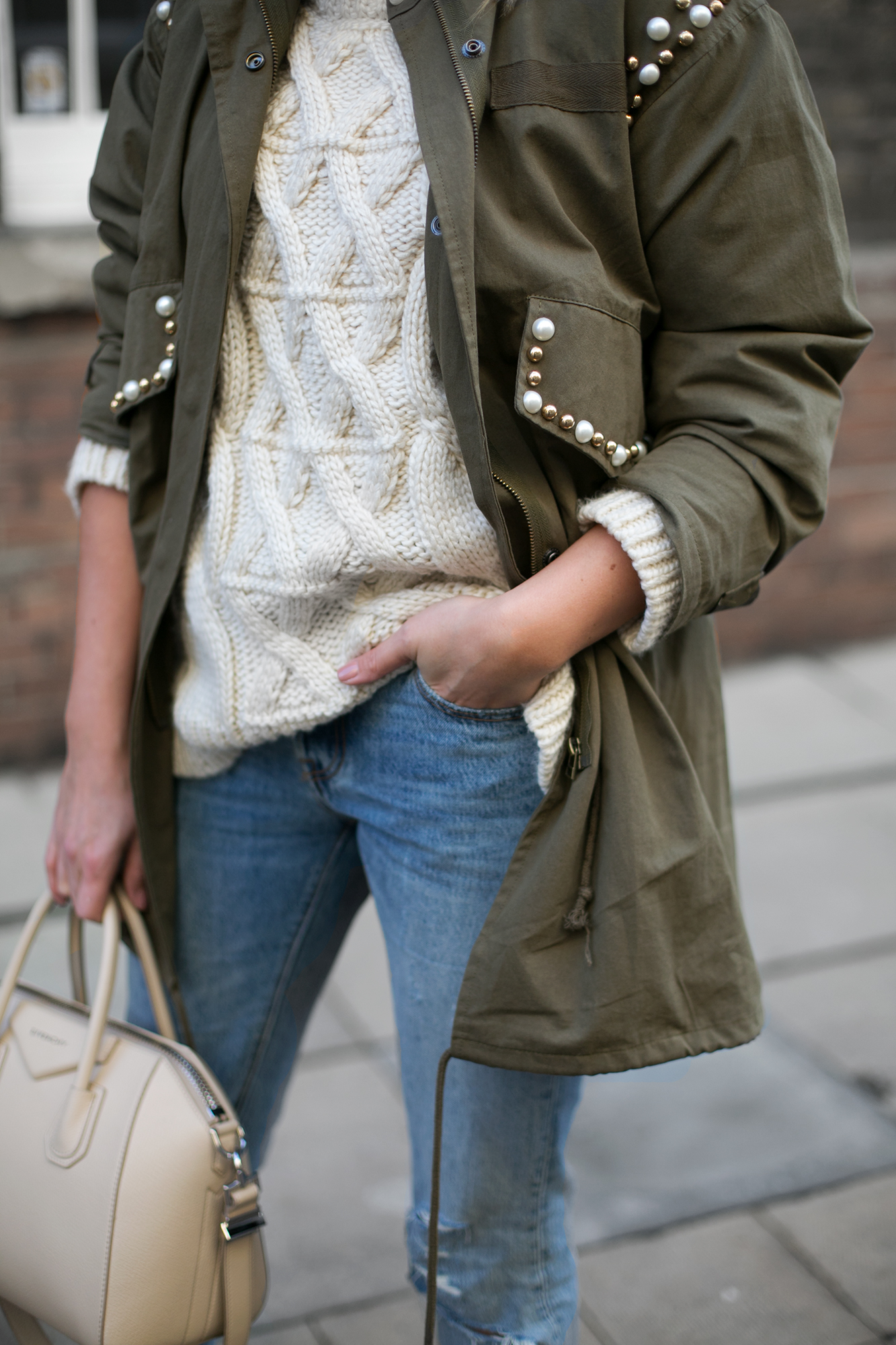 khaki embellished jacket, ripped Levis 501 jeans, cream cable knit jumper, cream Givenchy antigona bag small, beige suede Jimmy Choo Roma pumps, chic winter outfit