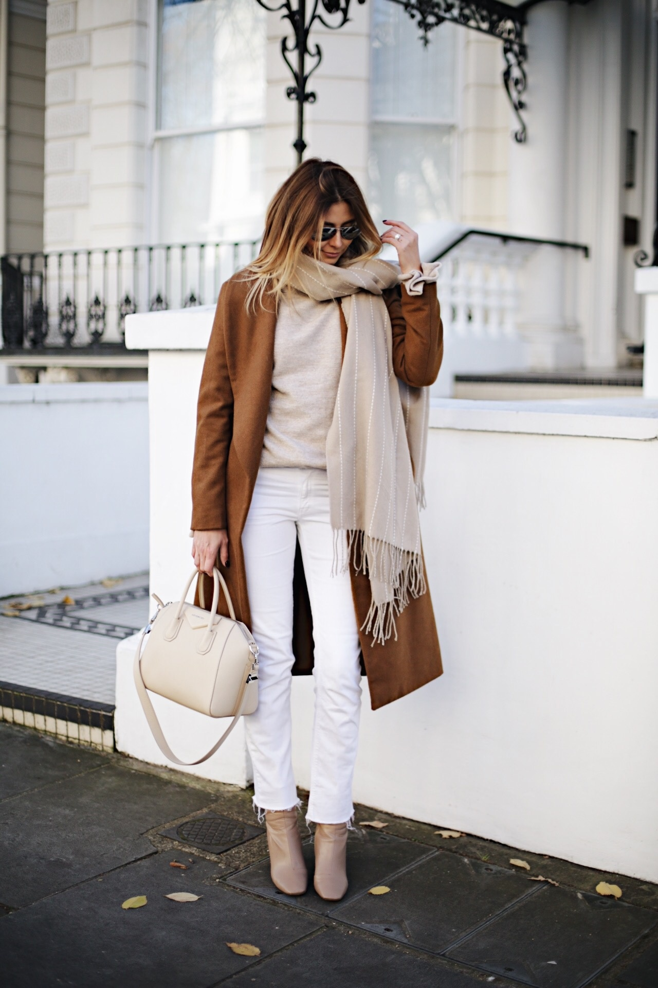Rust winter coat, white jeans, beige sweater, off white Givenchy Antigona bag small, beige sock boots, chic winter outfit, winter laters
