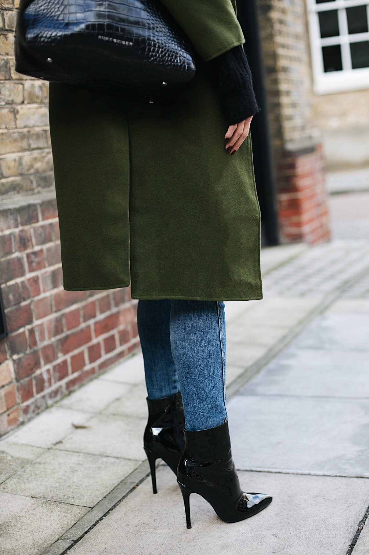 khaki coat, skinny jeans, black patent vinyl pvc heeled ankle boots