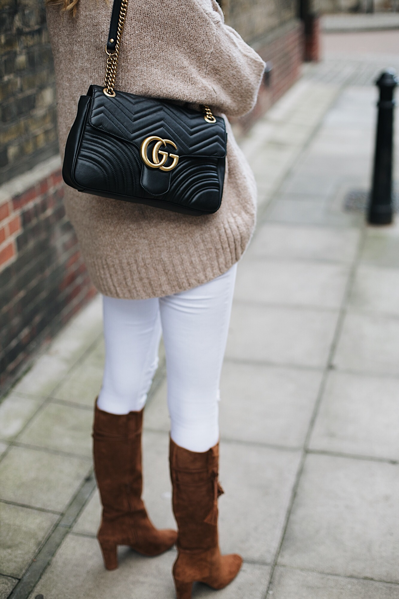 white skinny jeans, tan suede knee high boots, black leather Gucci Marmont bag