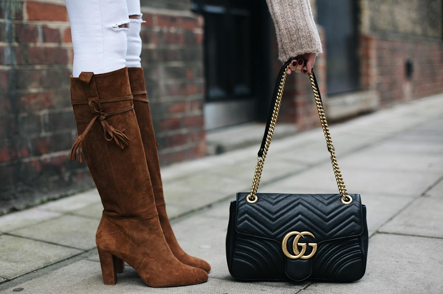 tan suede knee high block heel boots, white ripped knee skinny jeans black leather Gucci Marmont bag