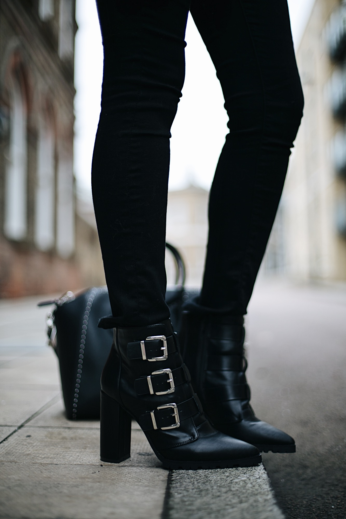 Black buckled ankle boots with block heel