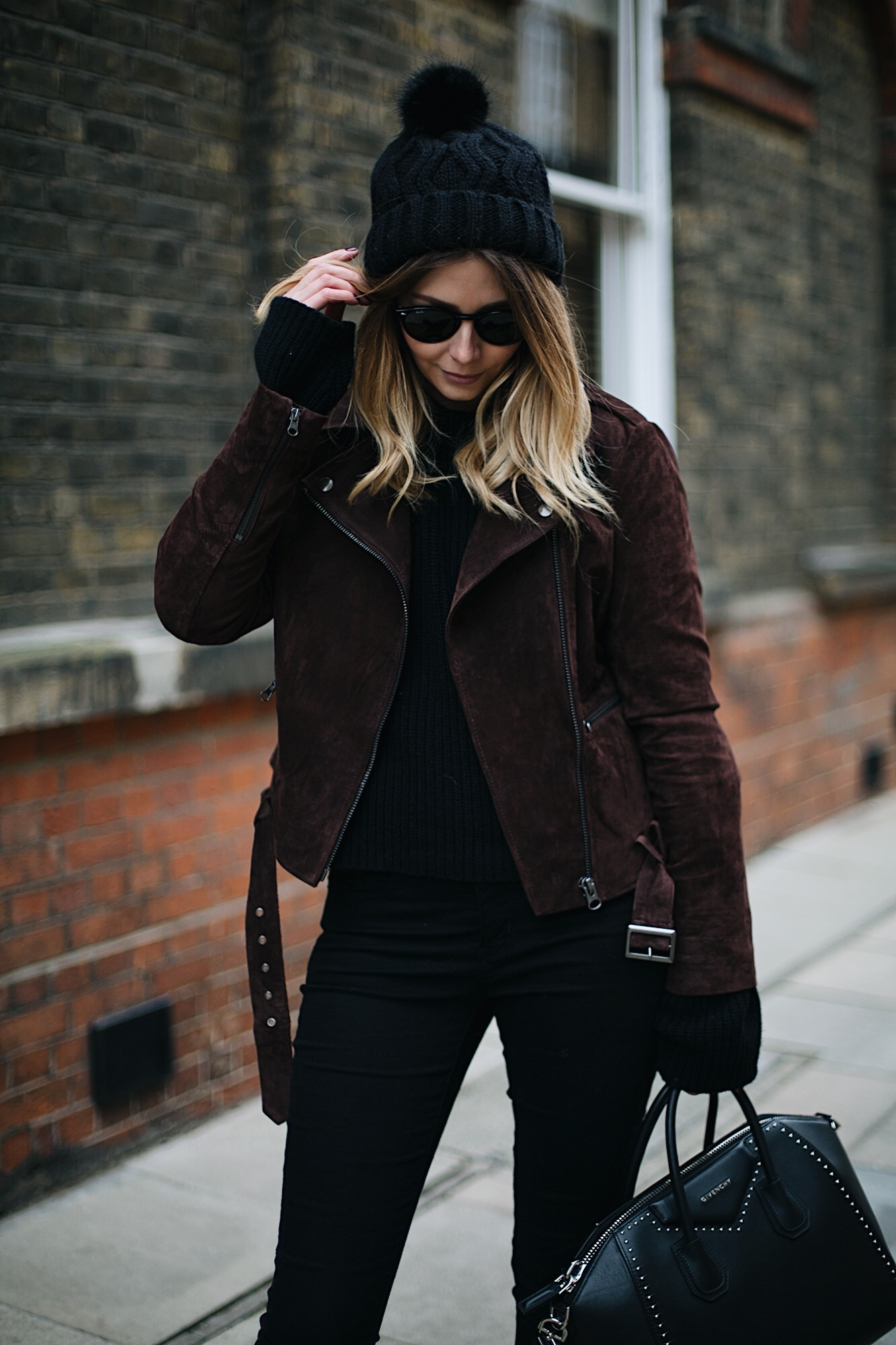 brown suede jacket, black sweater, black knitted hat, skinny jeans, winter outfit