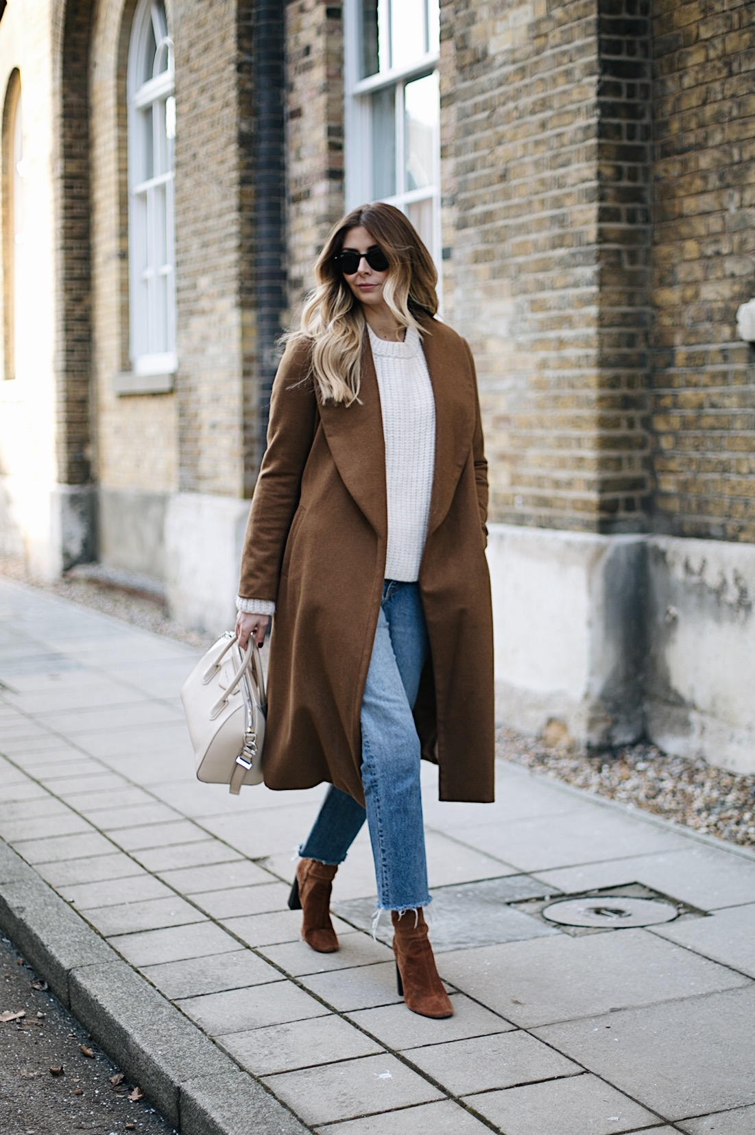 Emma Hill wears Tan coat, cream sweater, frayed hem jeans, givenchy antigona small ivory, tan suede boots, winter outfit