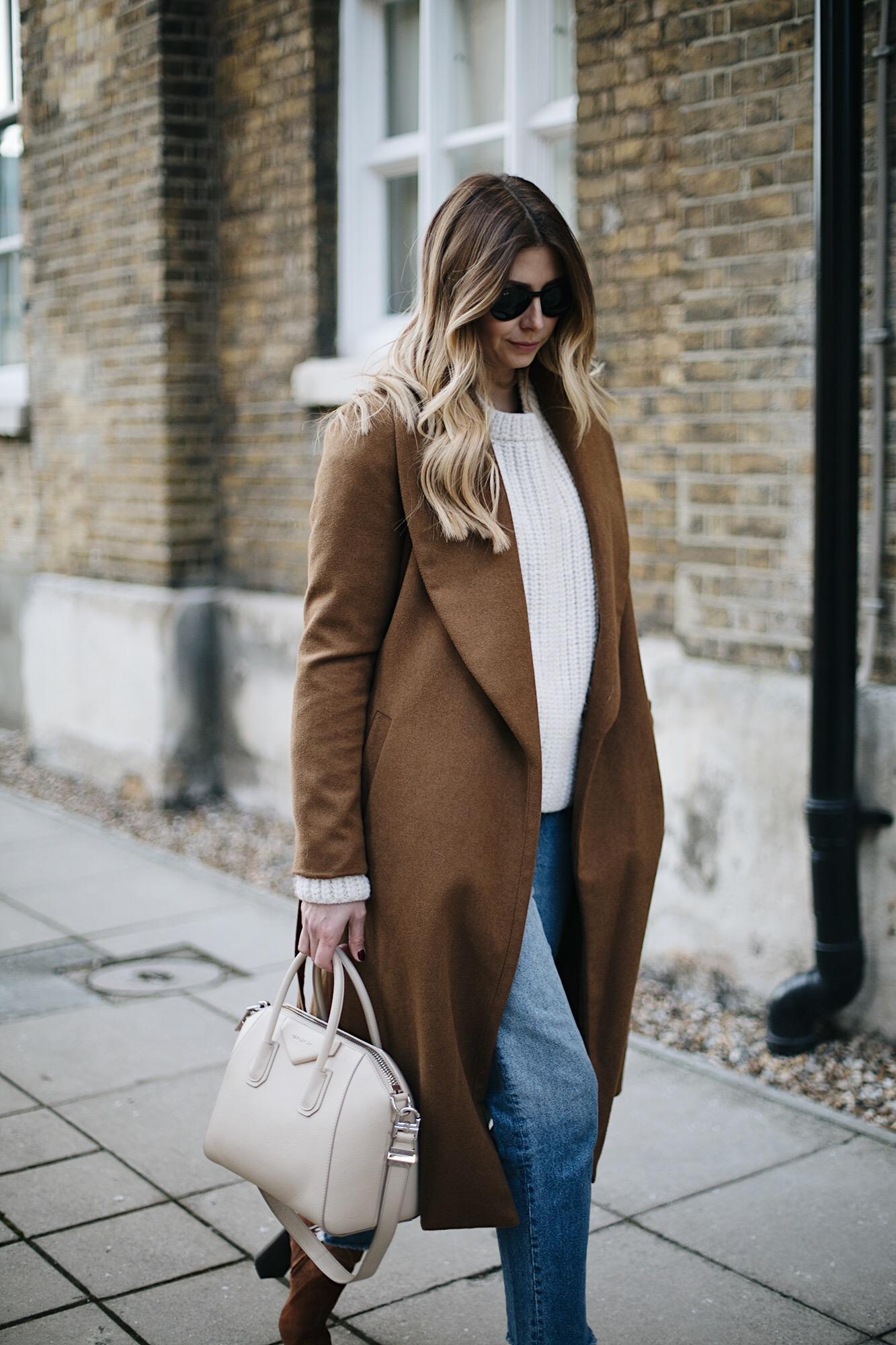 Tan coat, cream sweater, frayed hem jeans, givenchy antigona small ivory
