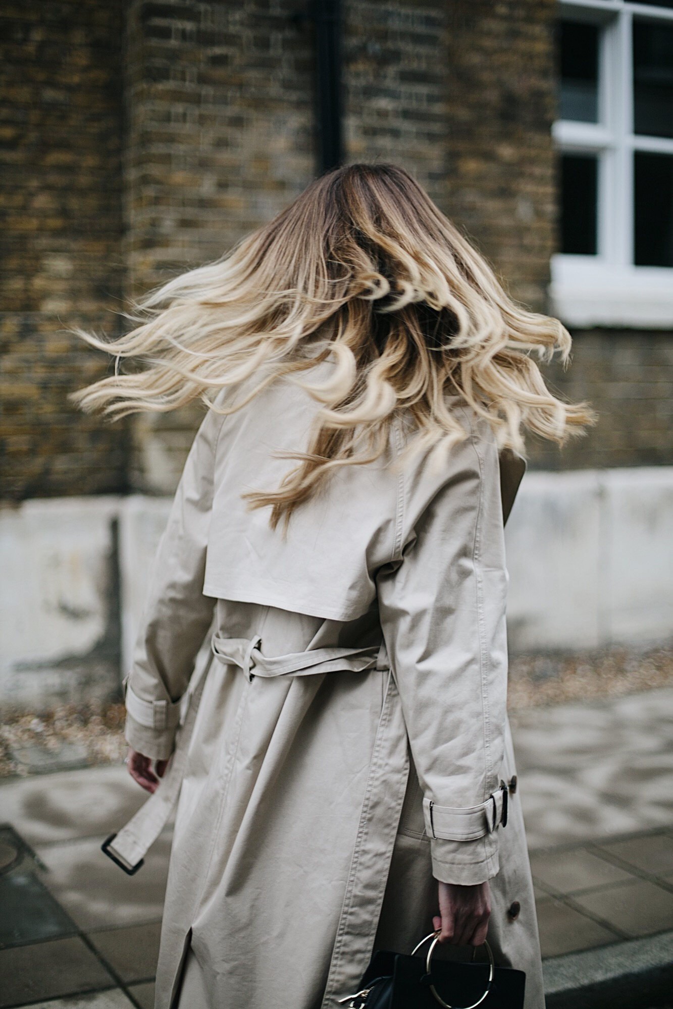 trench coat, long blonde hair