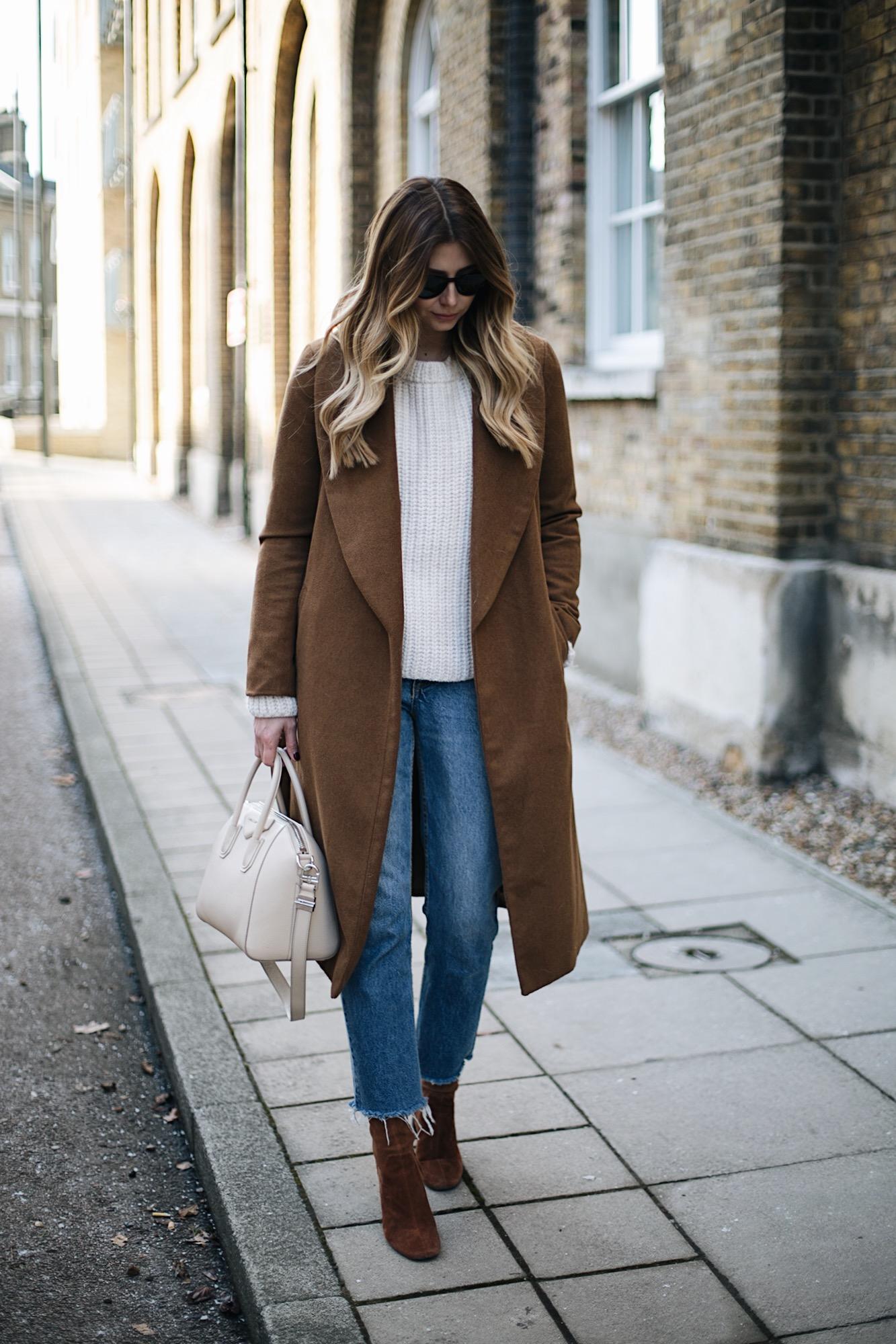 Tan coat, cream sweater raw hem jeans, tan suede boots, givenchy antigona bag