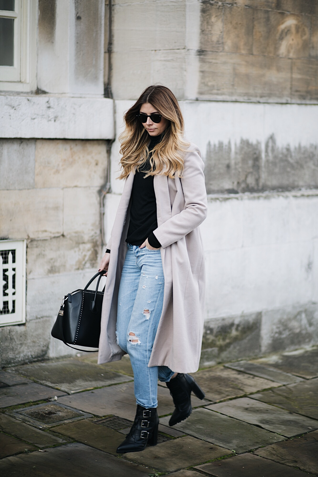 Emma Hill wears nude swing coat, studded medium Givenchy Antigona bag, bleach wash boyfriend jeans, winter style, winter outfit ideas
