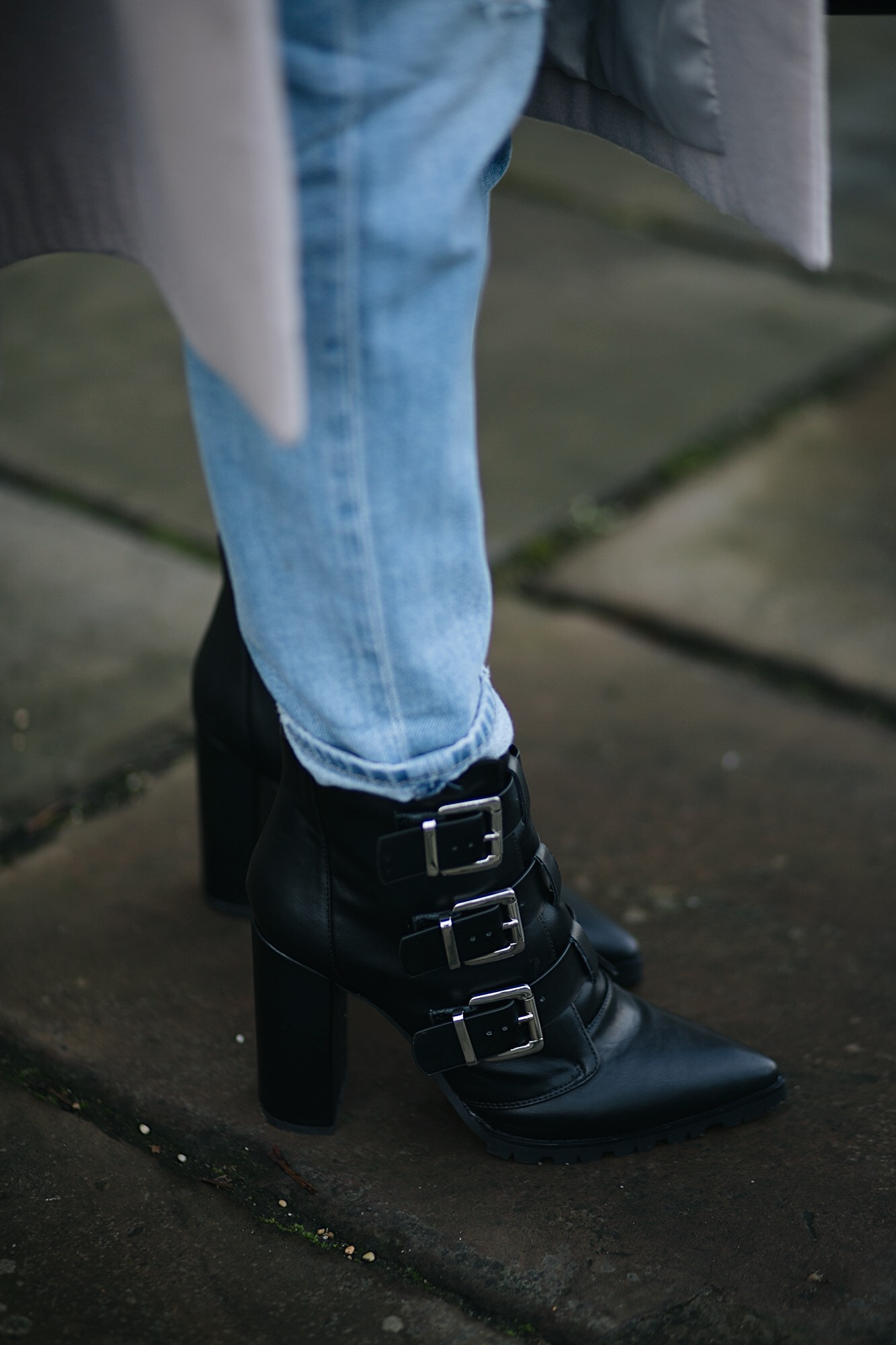 black buckle block heels ankle boots worn with rolled up boyfriend jeans