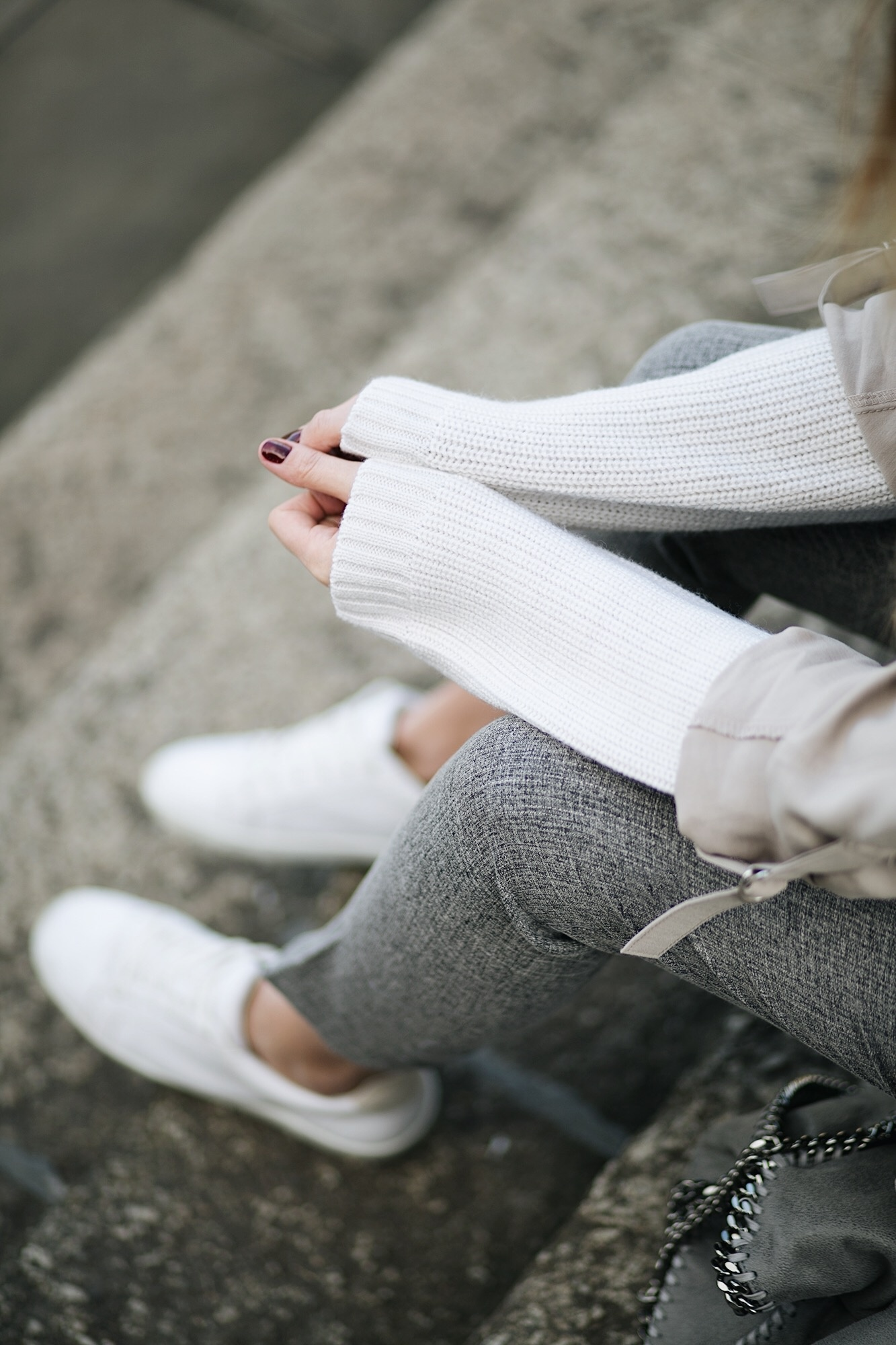 white jumper, grey trousers, white trainers, dark red nails, neutral outfit