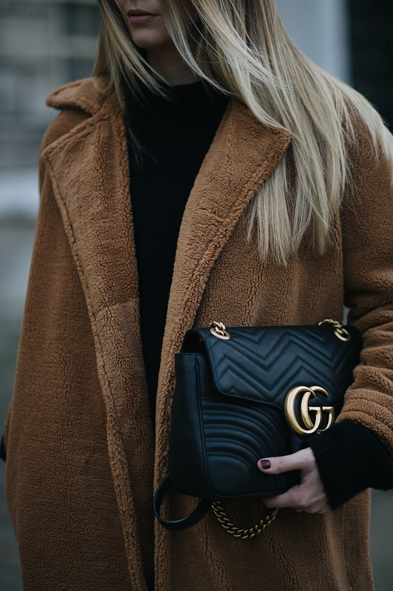 camel teddy coat, black leather medium size Gucci Marmont bag
