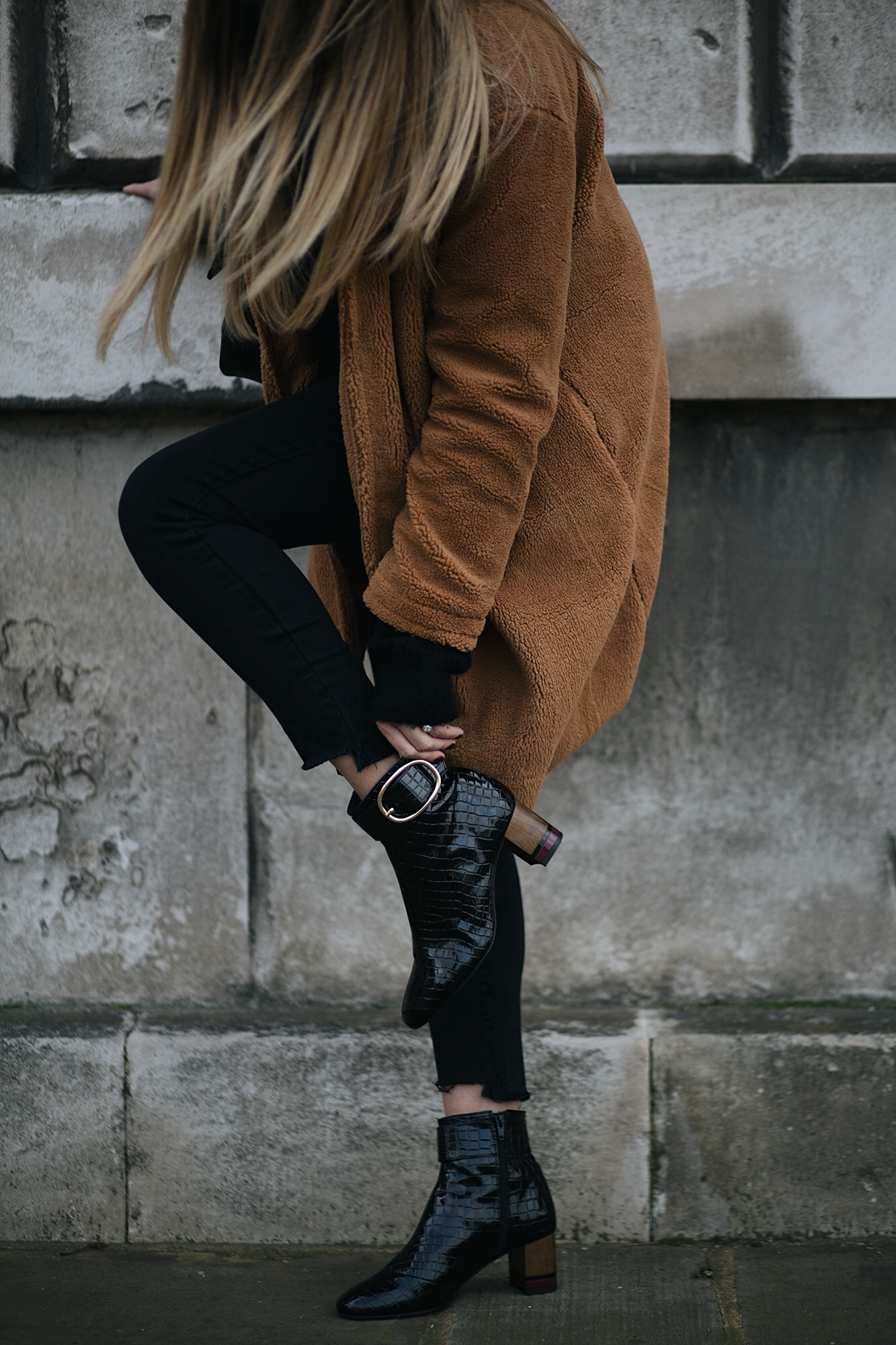 camel teddy coat, black raw hem jeans, patent croc ankle boots, winter outfit