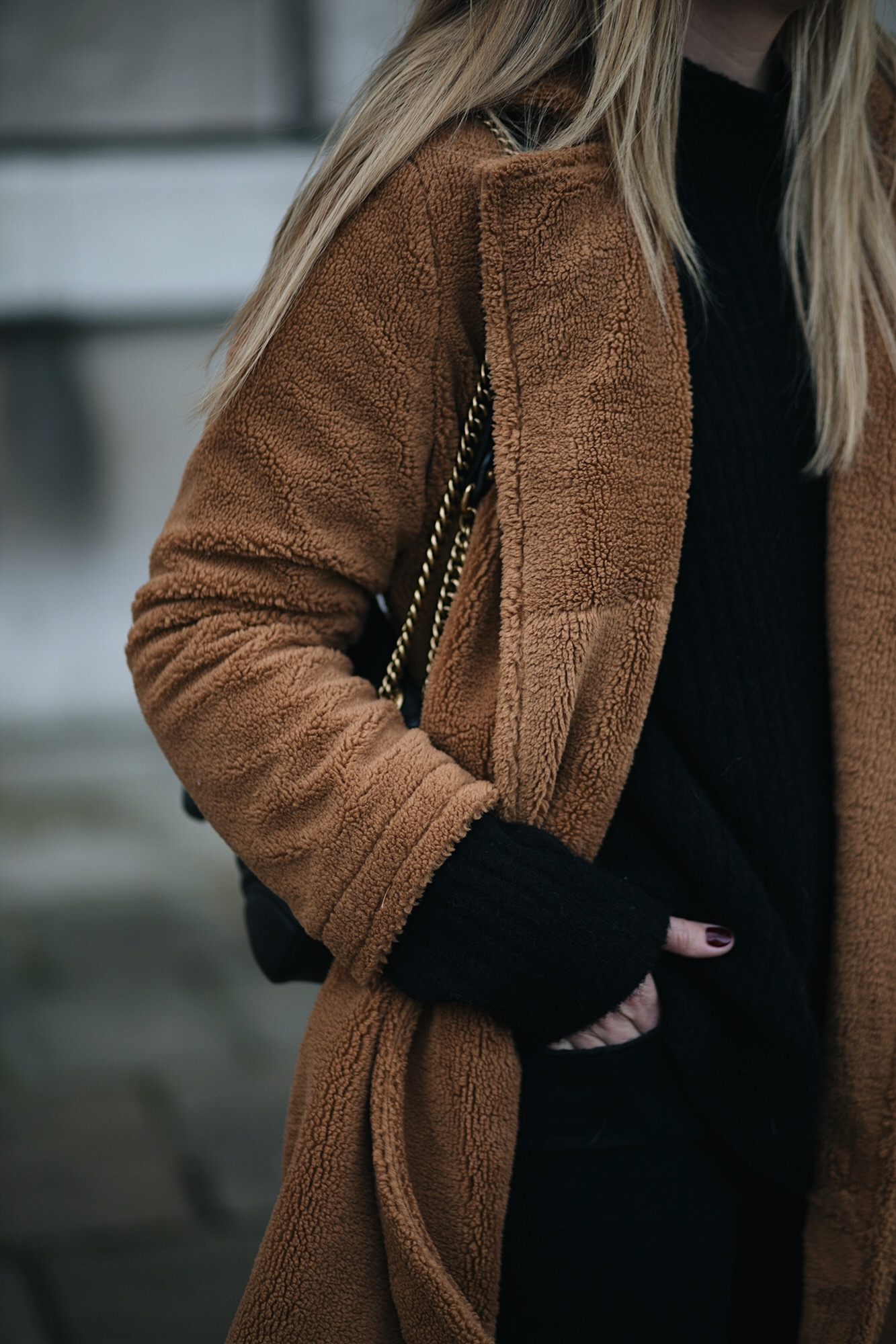 black sweater, camel teddy coat