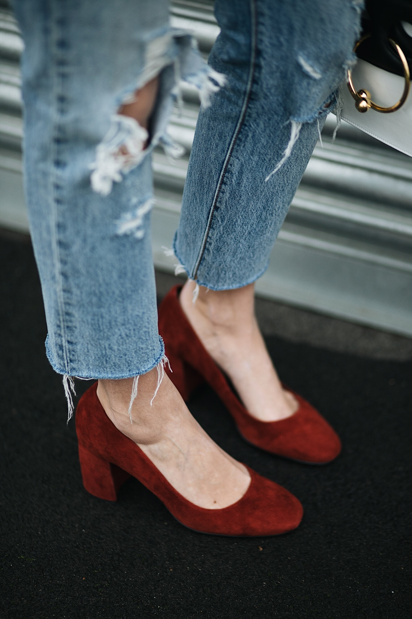 ripped raw hem levis jeans, rust suede block heel shoes