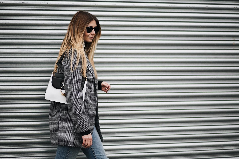 check blazer, black sweater, levis jeans, JW Anderson Pierce bag