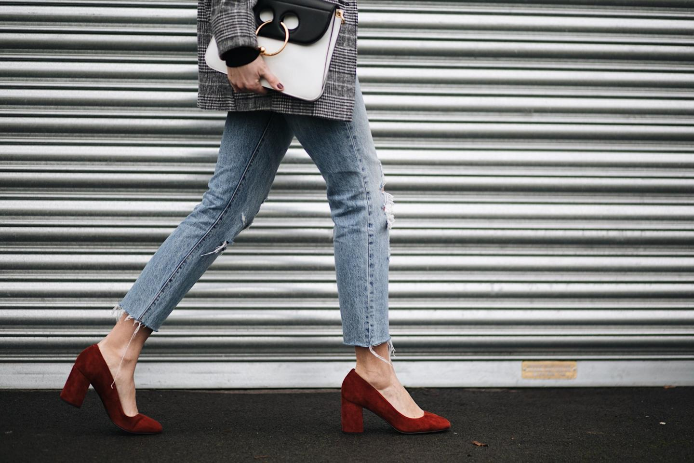 ripped jeans, ruse suede block heel shoes, J.W. Anderson black white Pierce bag, check blazer