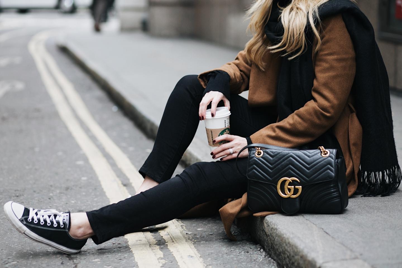 EJ Style - Black skinny jeans, black chuck low Converse, Gucci Marmont bag, camel coat, black scarf