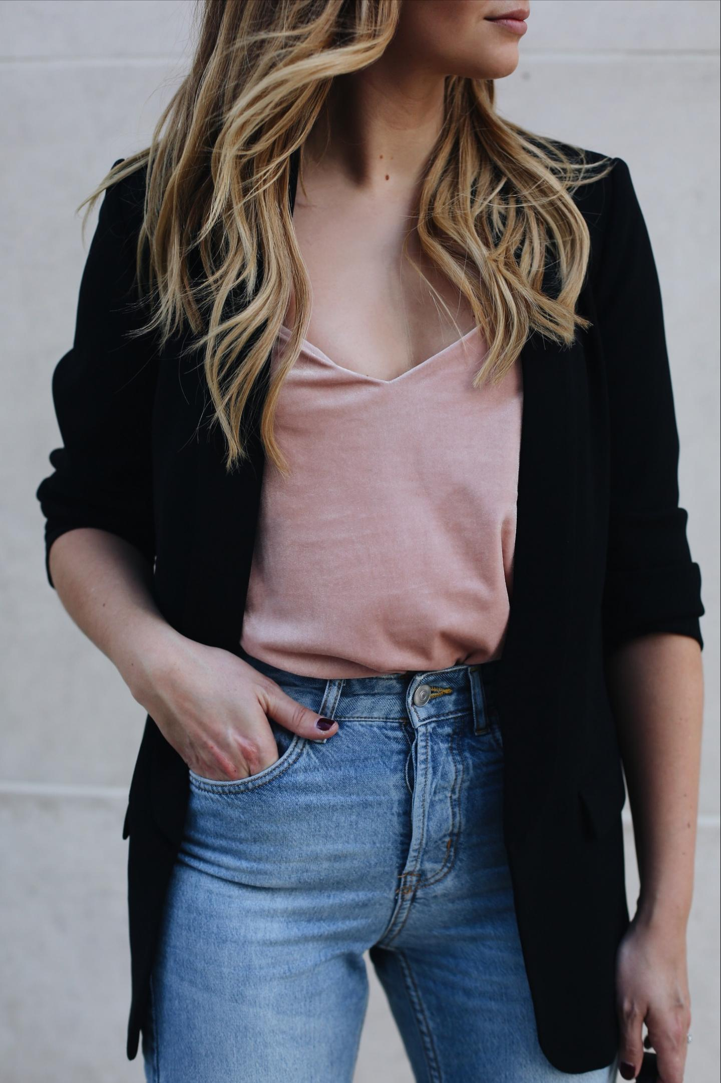 Emma Hill wears pink velvet came top, black blazer, ripped hem frayed jeans