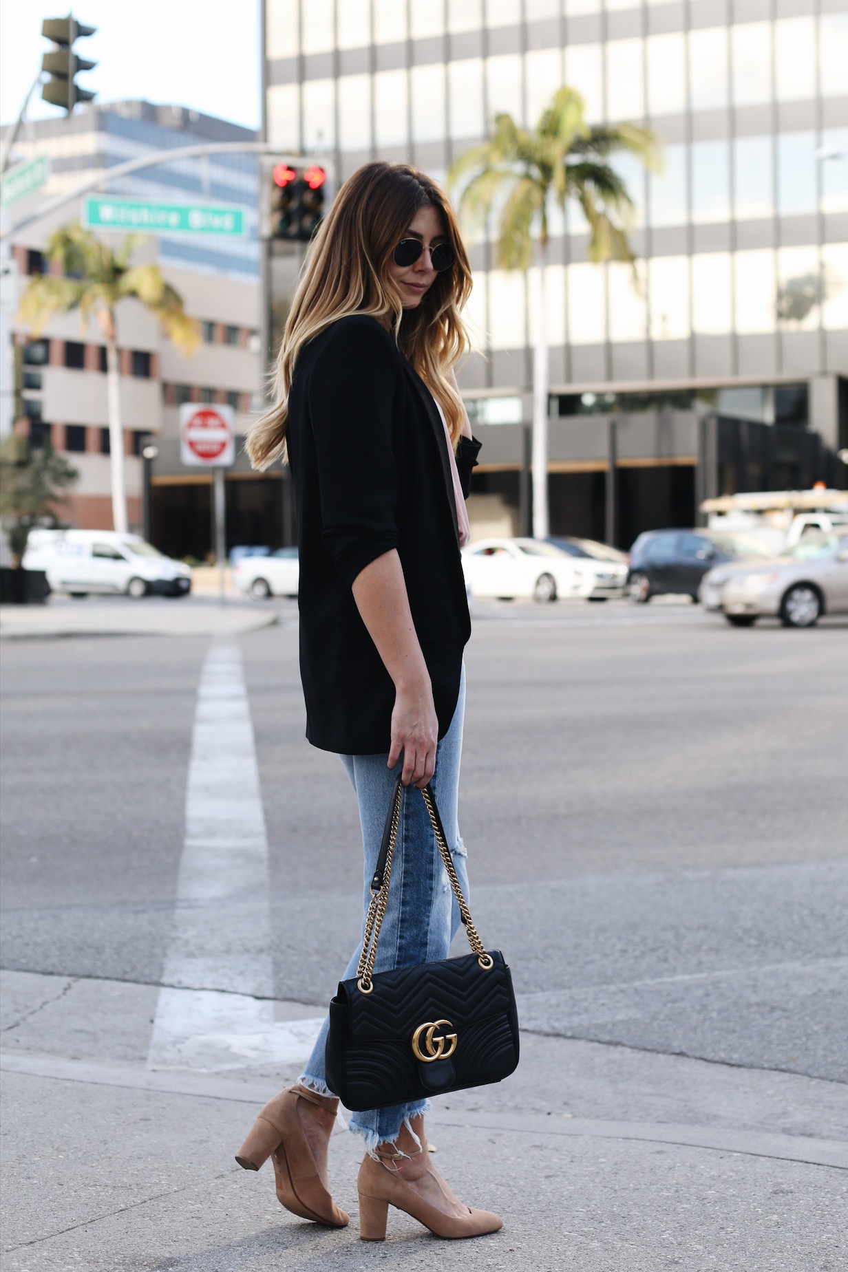 Emma Hill wears pink velvet came top, black blazer, ripped hem frayed jeans, Gucci Marmont bag, beige suede mid heels