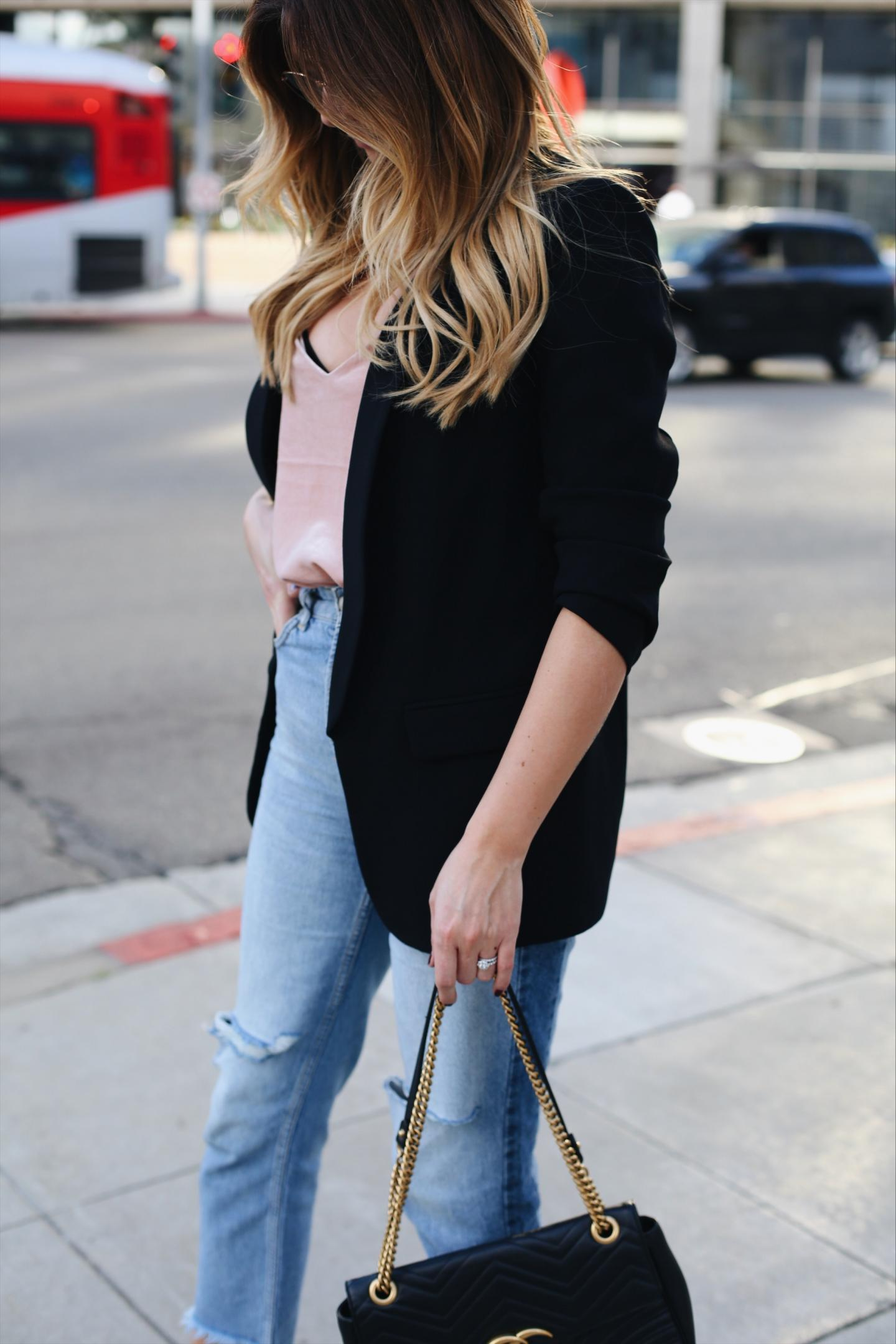 Emma Hill EJStyle wears pink velvet came top, black blazer, bleach wash ripped jeans, Gucci Marmont bag in LA