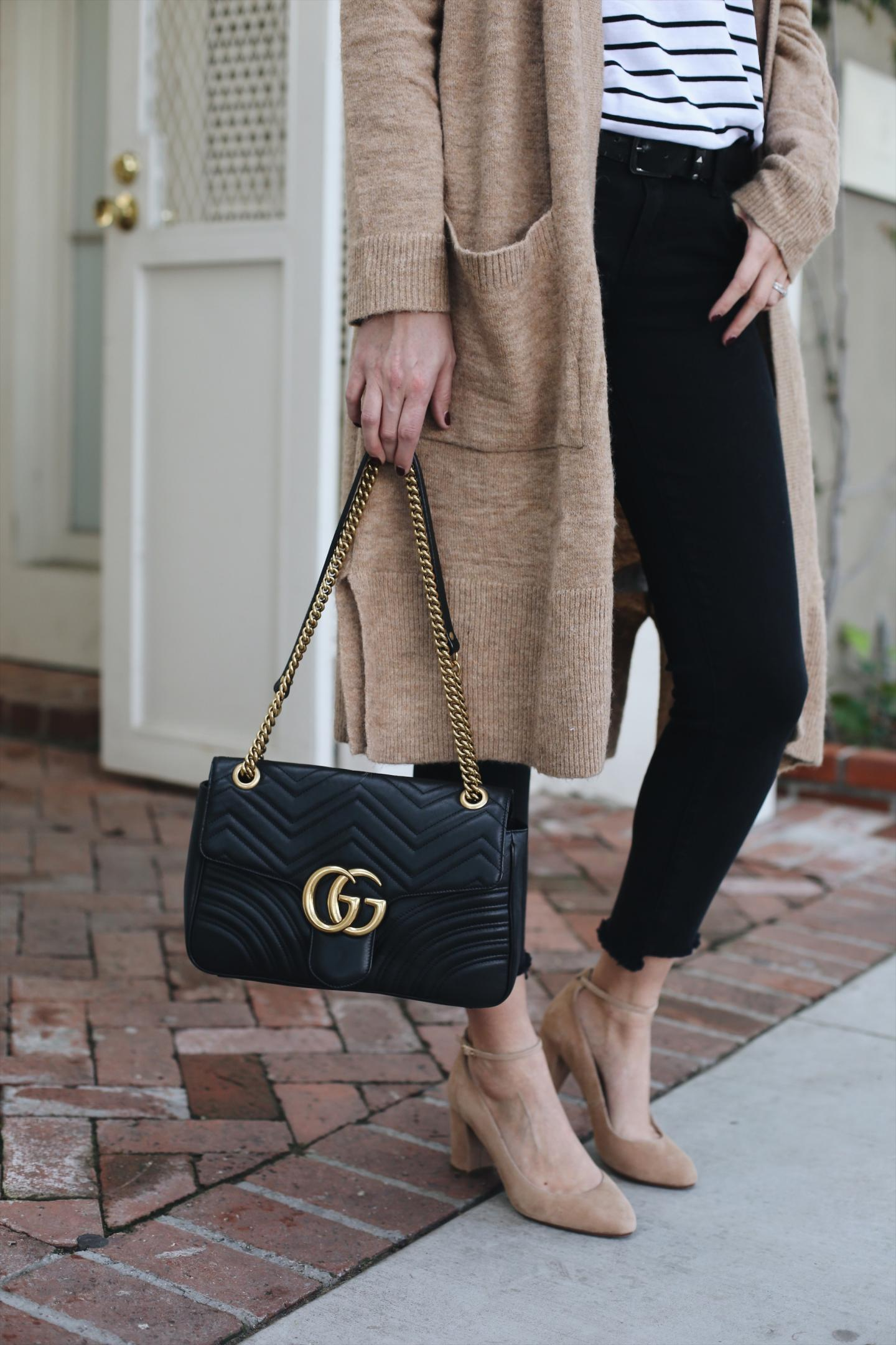camel cardigan, stripe t-shirt, black skinny jeans with stepped hem, Gucci medium black leather Marmont bag, nude suede court shoes