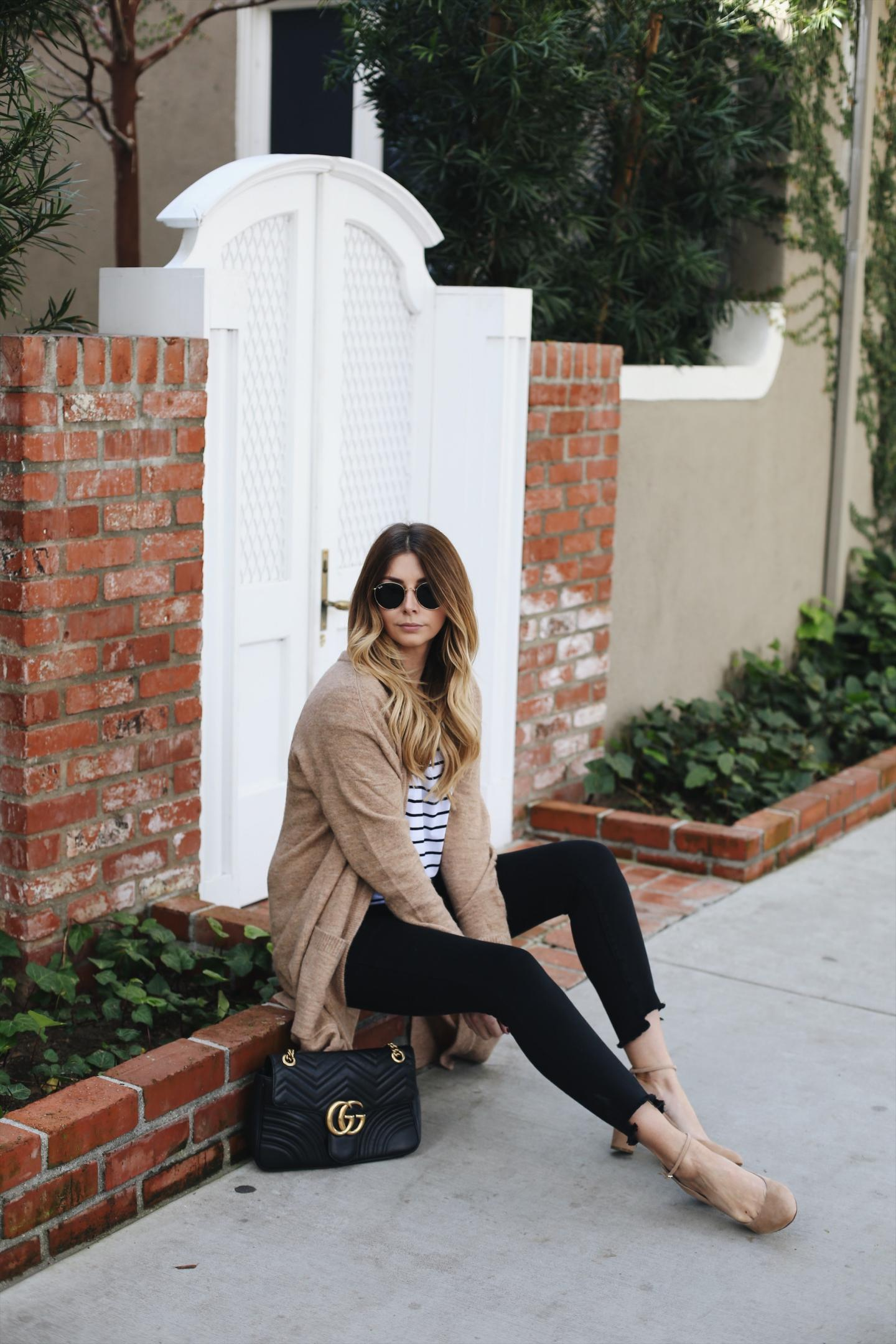 Emma Hill of EJStyle wears camel cardigan, stripe t-shirt, black skinny jeans, Gucci marmont bag, nude suede court shoes, casual outfit