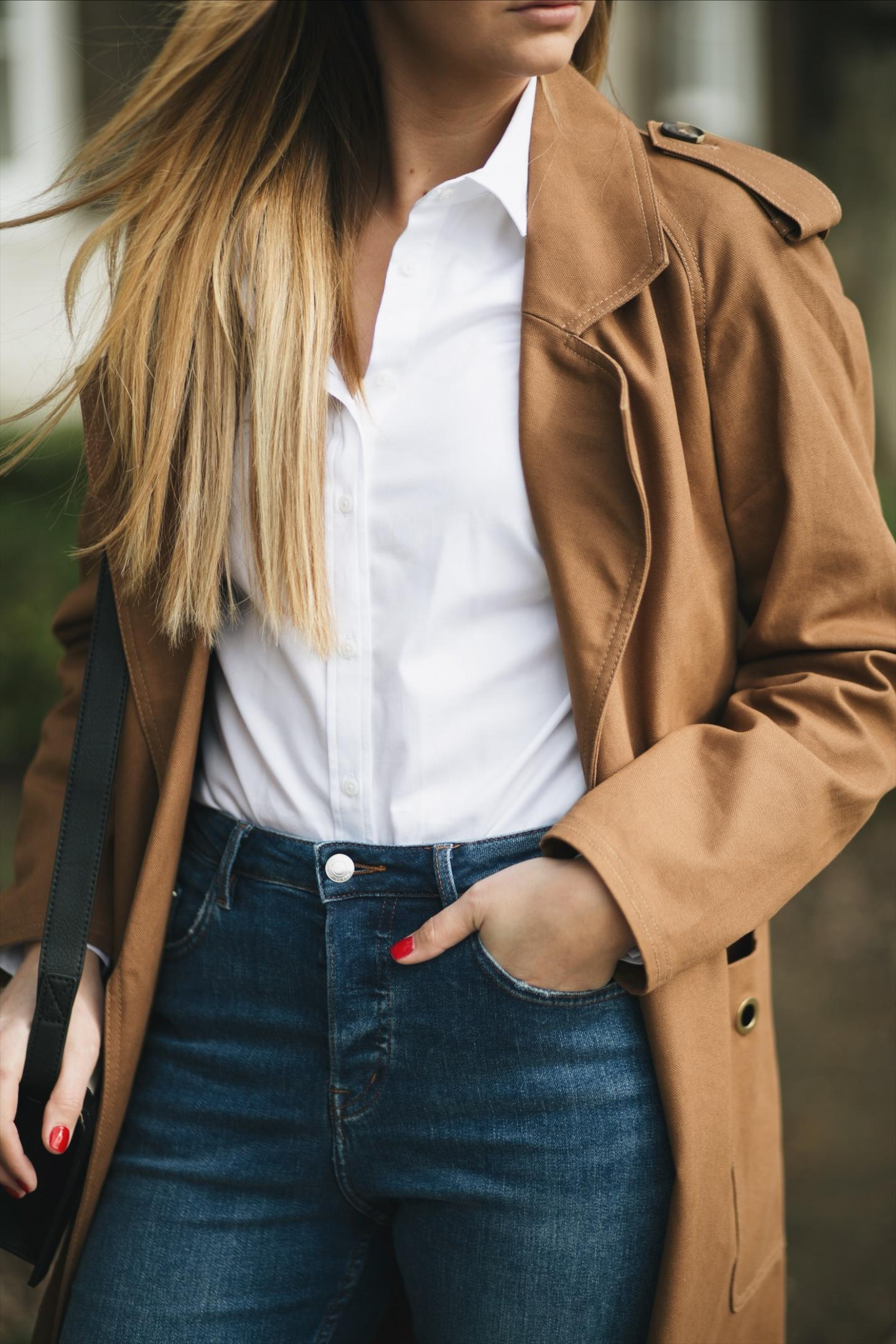 white shirt, camel trench coat, mid wash denim, red nails