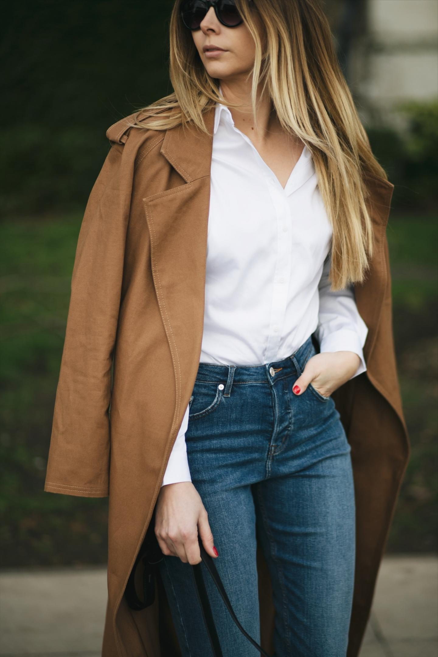 camel trench coat, white shirt, denim, small cross body shoulder bag