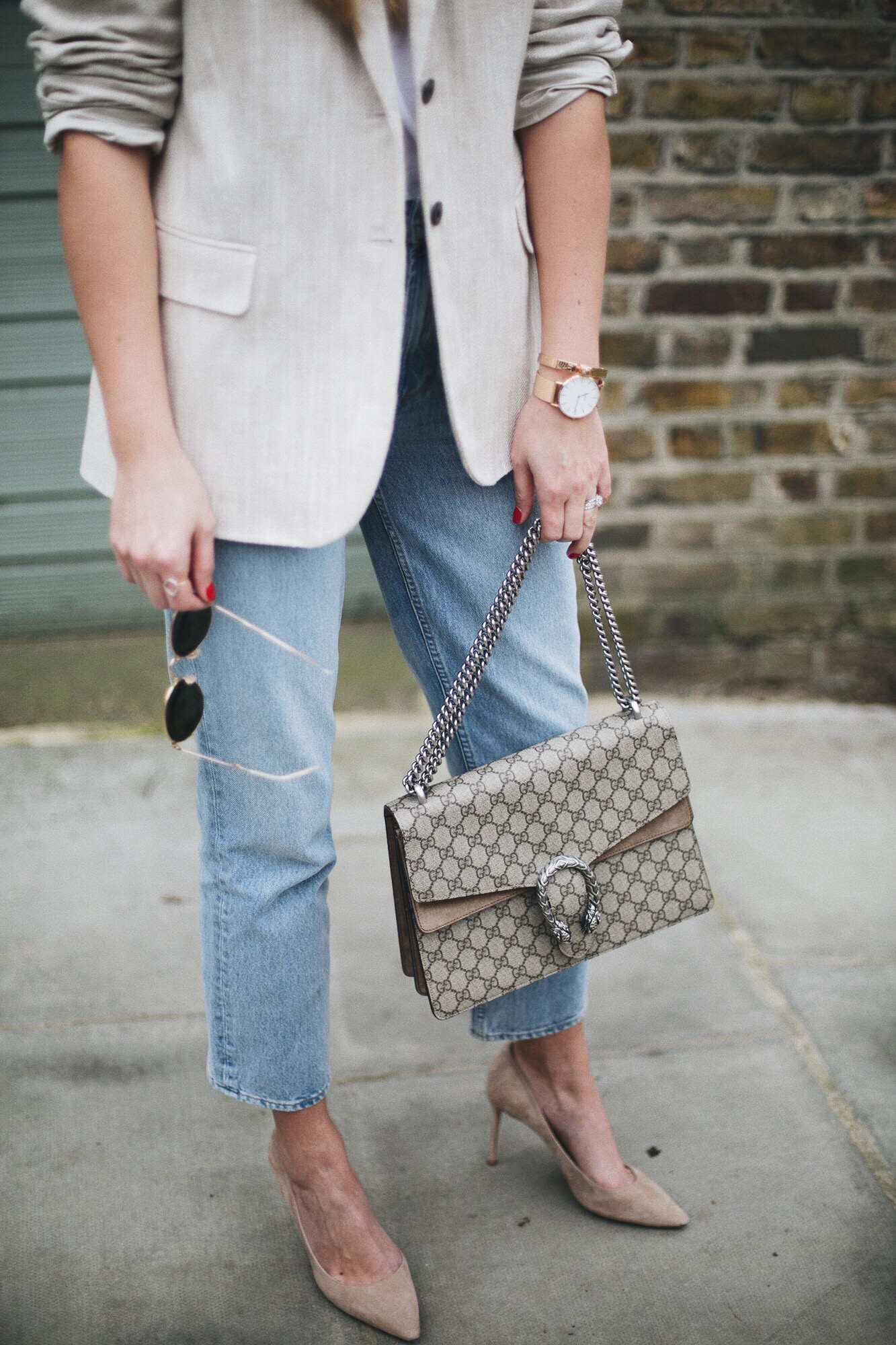beige linen blazer, light wash high waisted jeans, Gucci medium beige Dionysus bag, small arm tattoo, rose gold accessories, beige suede Jimmy Choo pumps