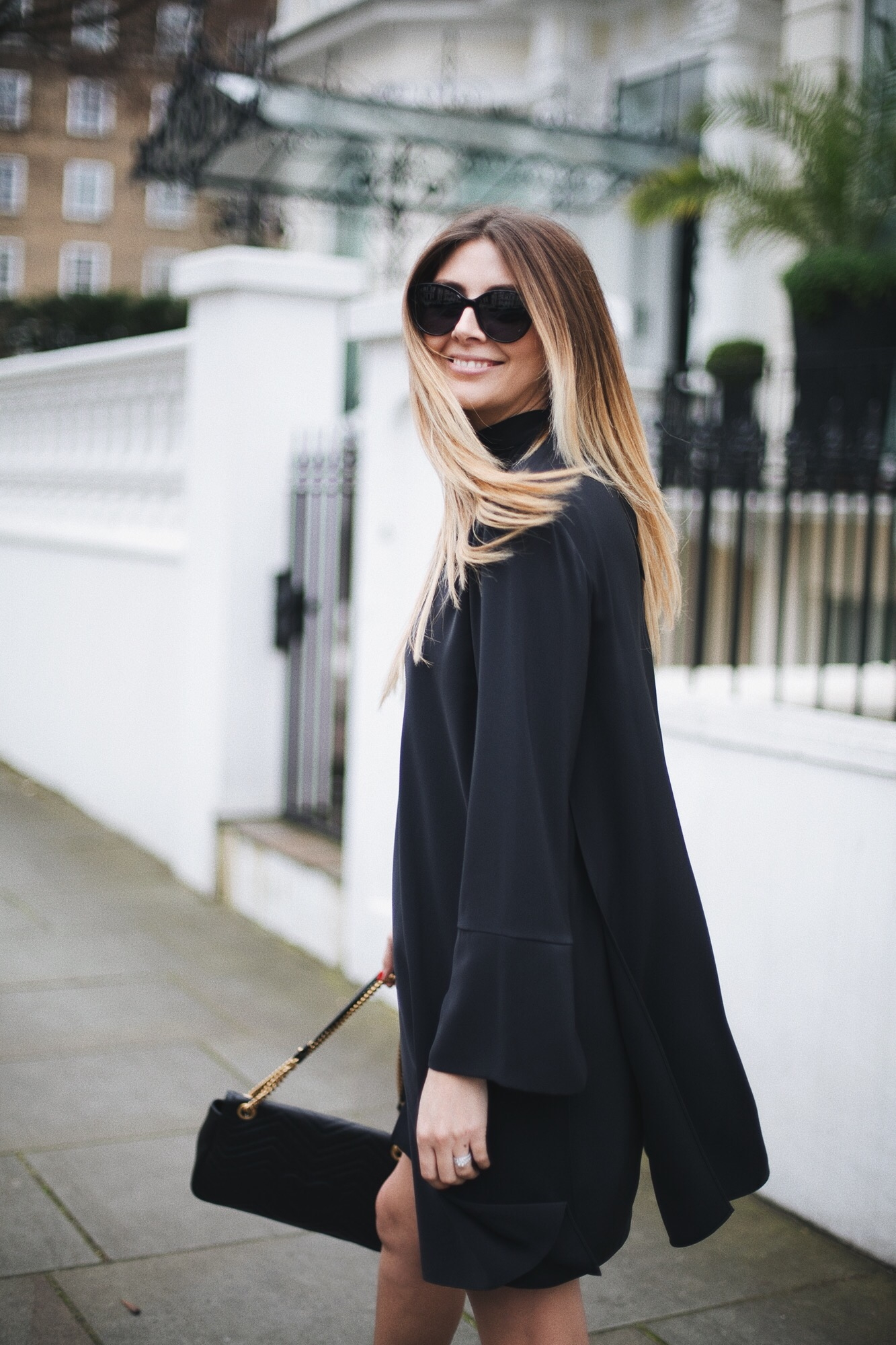 black swing dress, cat eye sunglasses