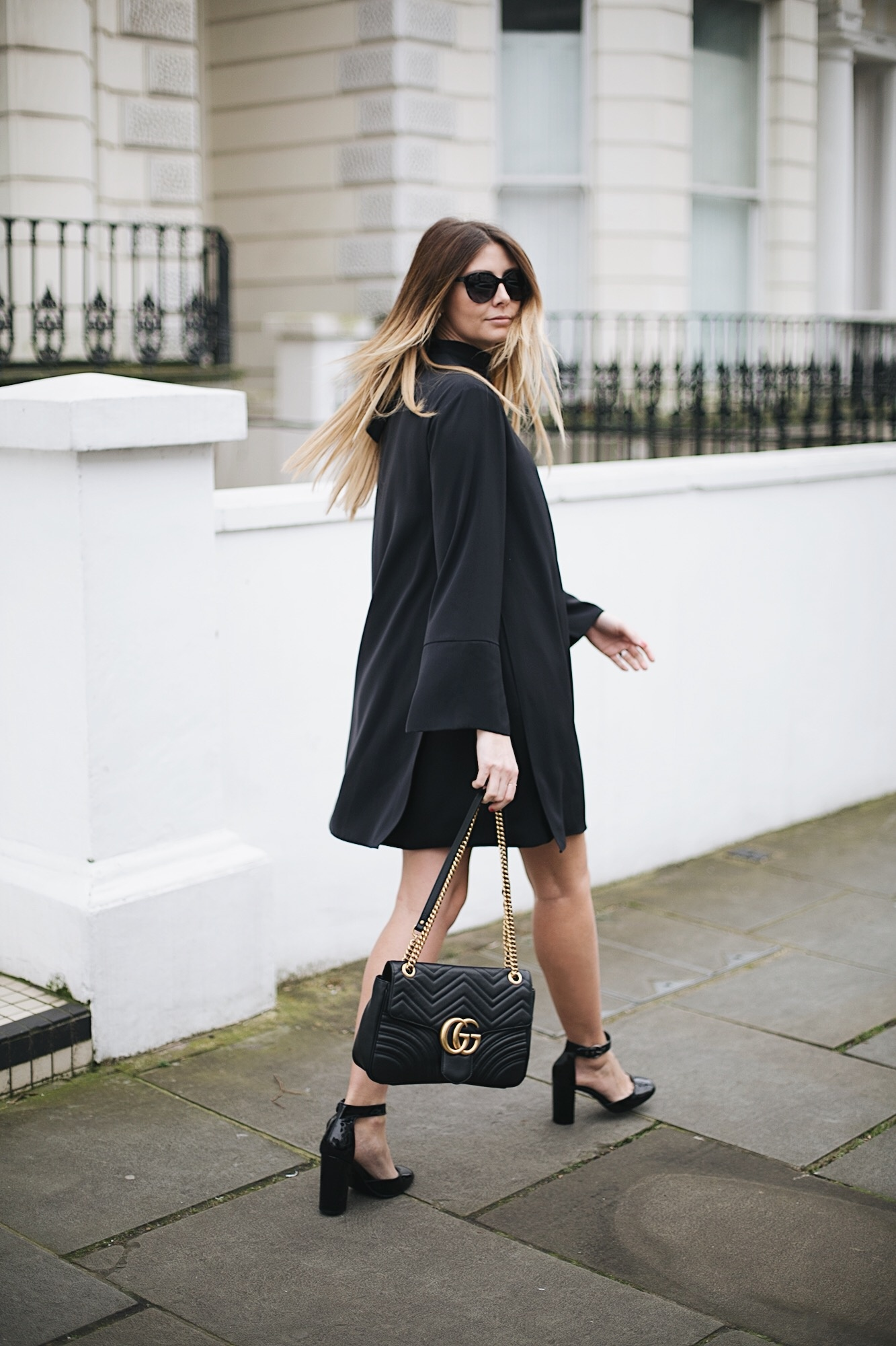 black swing dress, cat eye sunglasses, block heel Mary Jane sandals, Gucci Marmont bag