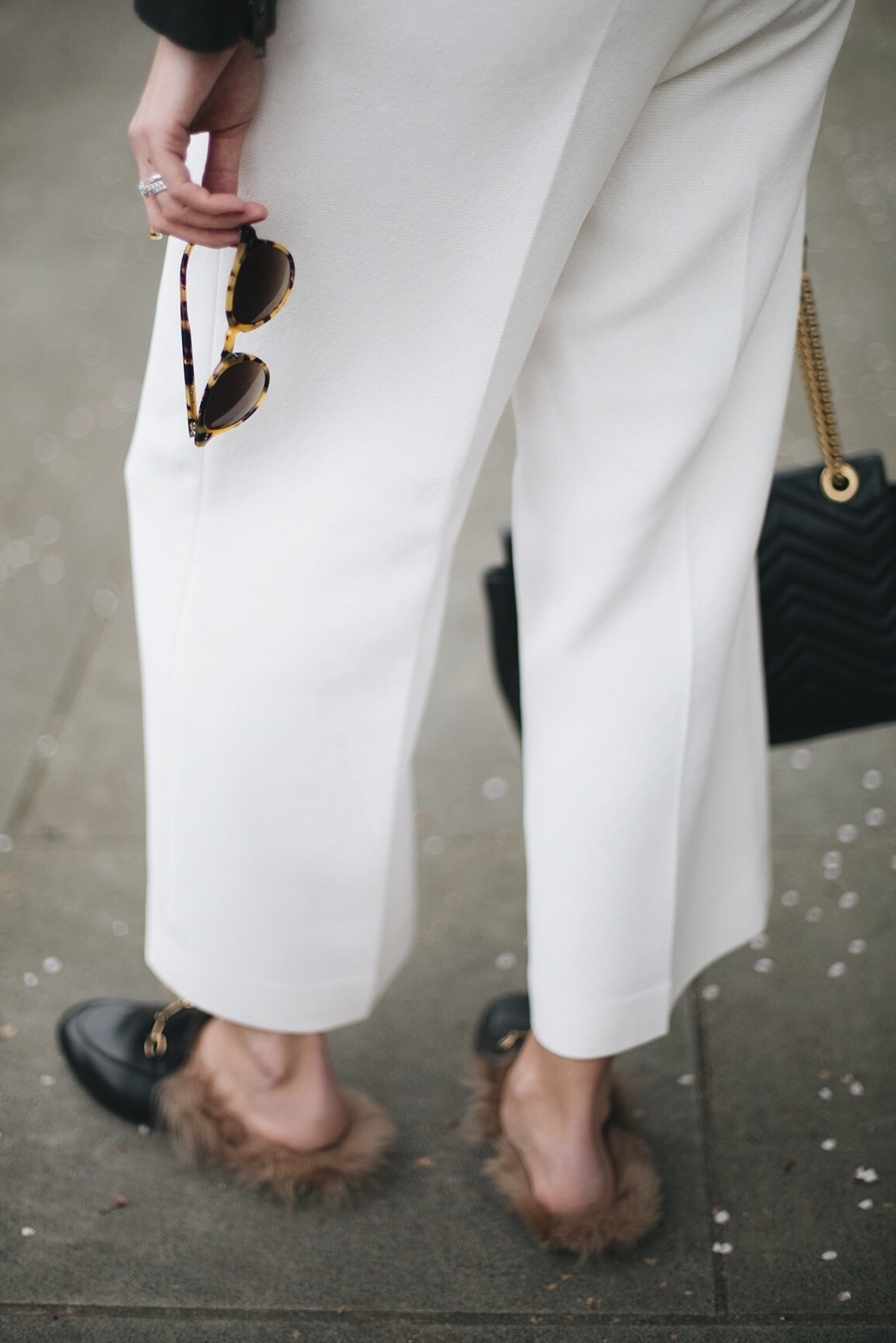 white wide leg cropped trousers, Gucci fur Princetown slippers, Gucci Marmont bag, round tortoiseshell sunglasses