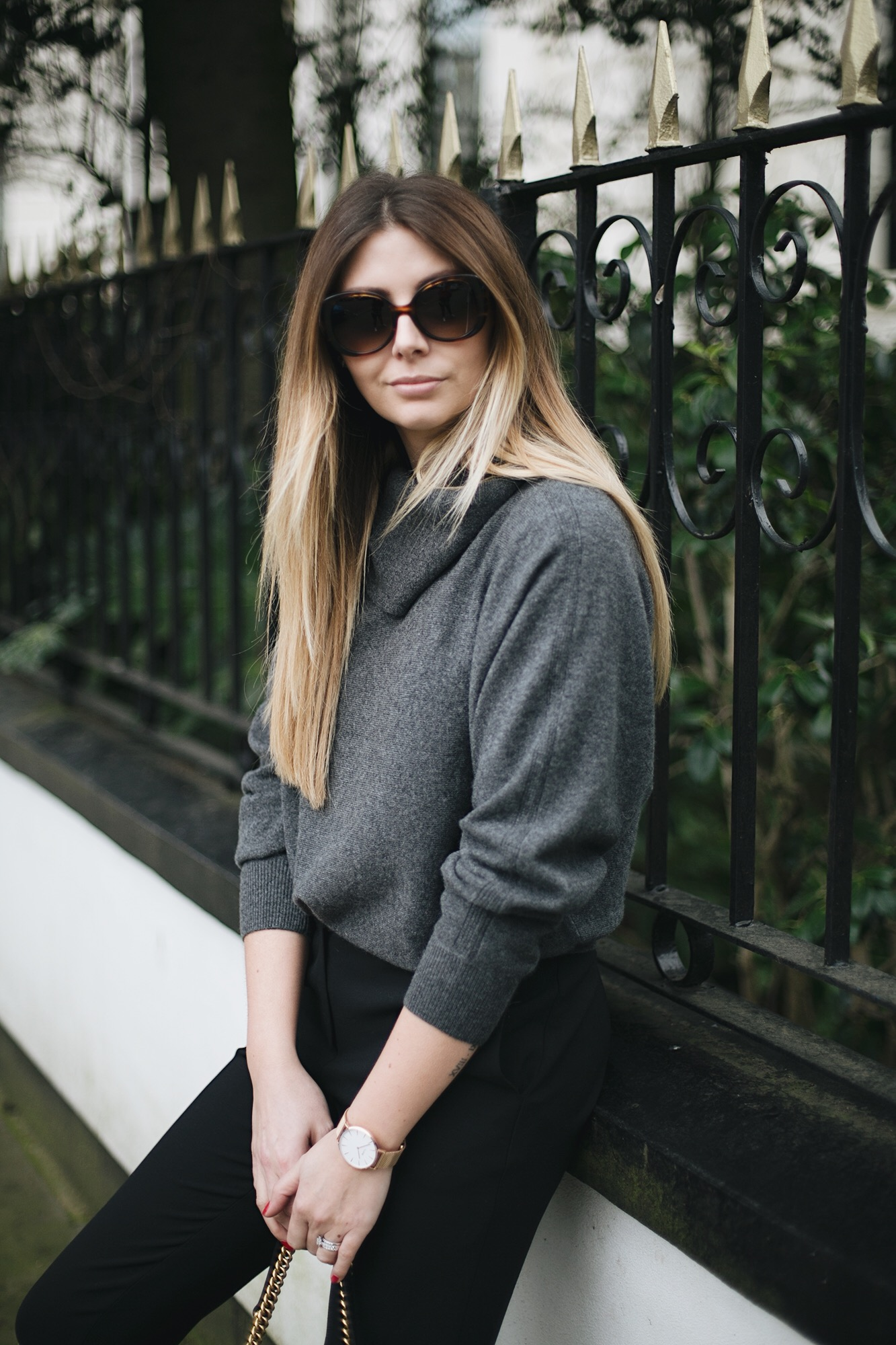 grey cashmere cowl neck sweater, black tailored trousers, oversized sunglasses