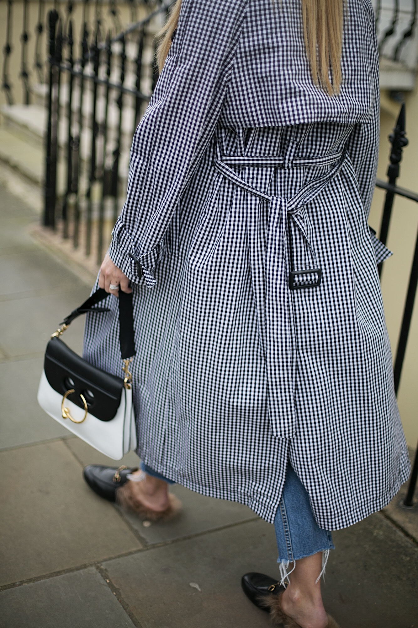 J.W. Anderson Pierce bag, gingham trench coat, Gucci Princetown fur slippers