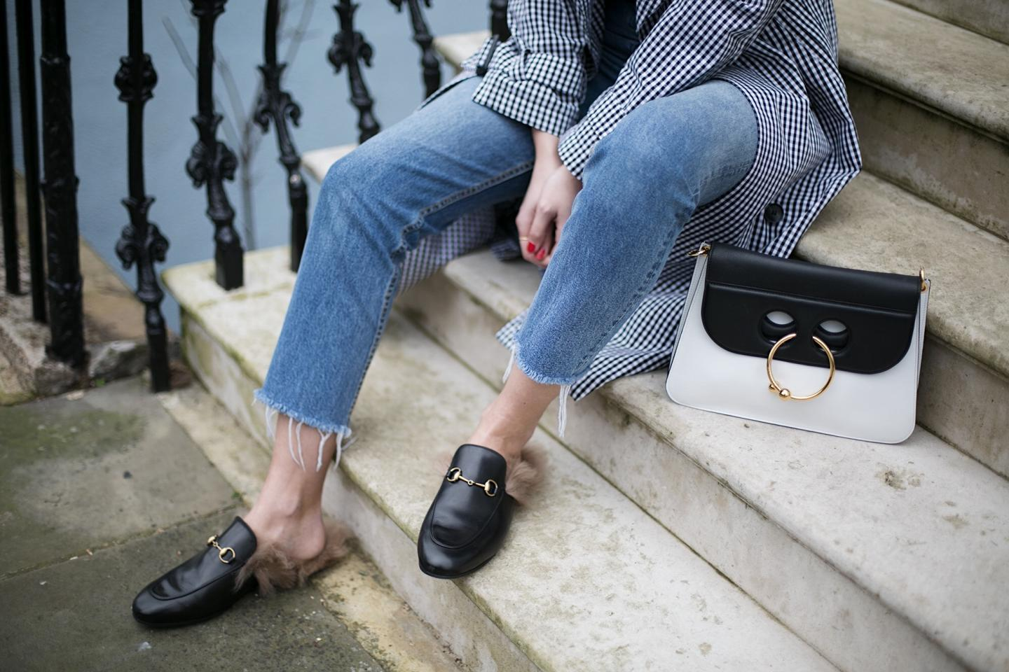 J.W. Anderson Pierce bag, gingham trench coat, Gucci Princetown fur slippers, frayed hem jeans