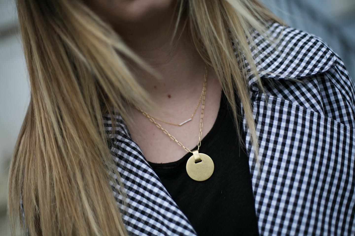 gingham trench coat, gold disc necklace, black t-shirt