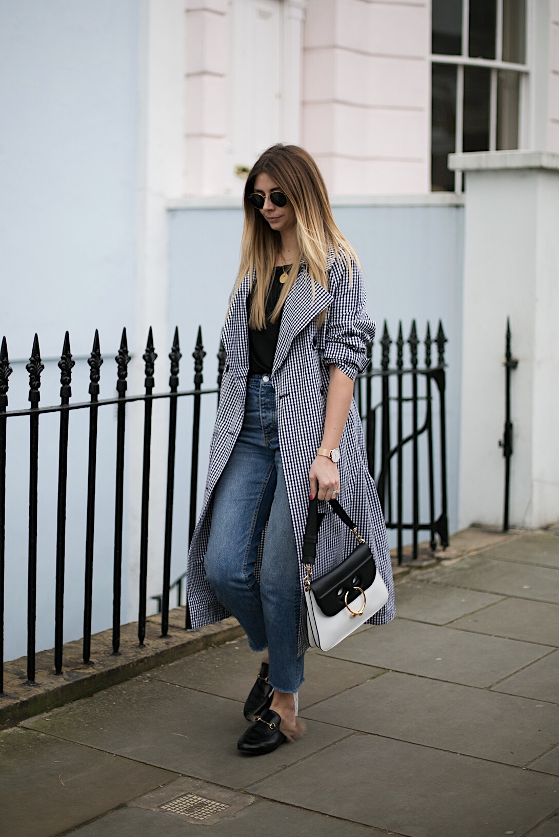 gingham trench coat, jeans, J.W. Anderson Pierce bag, black t-shirt, gold jewellery, Gucci Princetown fur slippers, Spring outfit