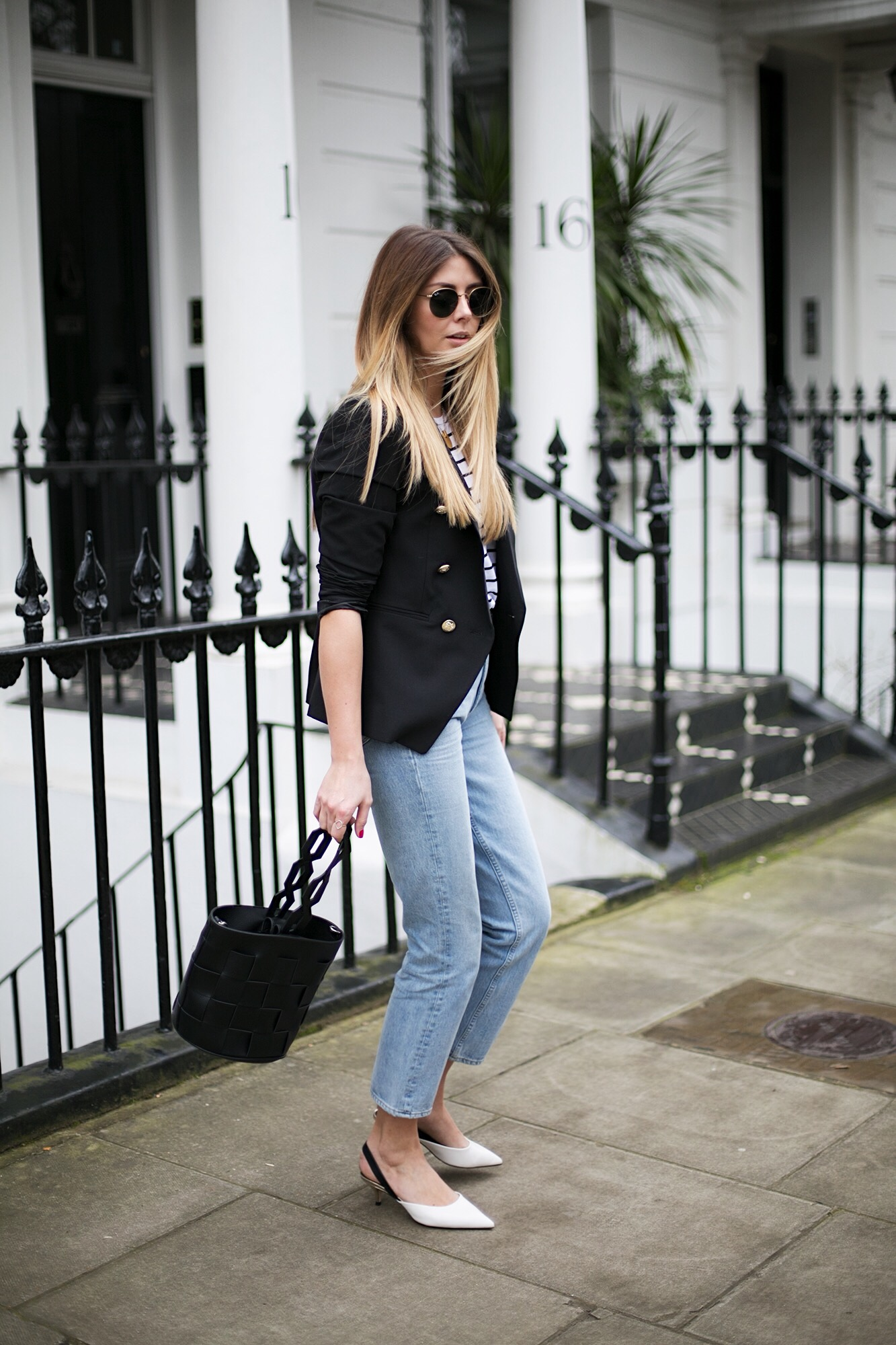 Stripe t-shirt, black military blazer, light wash high waisted jeans, black belt, round rayon sunglasses, black bucket bag, white kitten heel sing backs, spring outfit