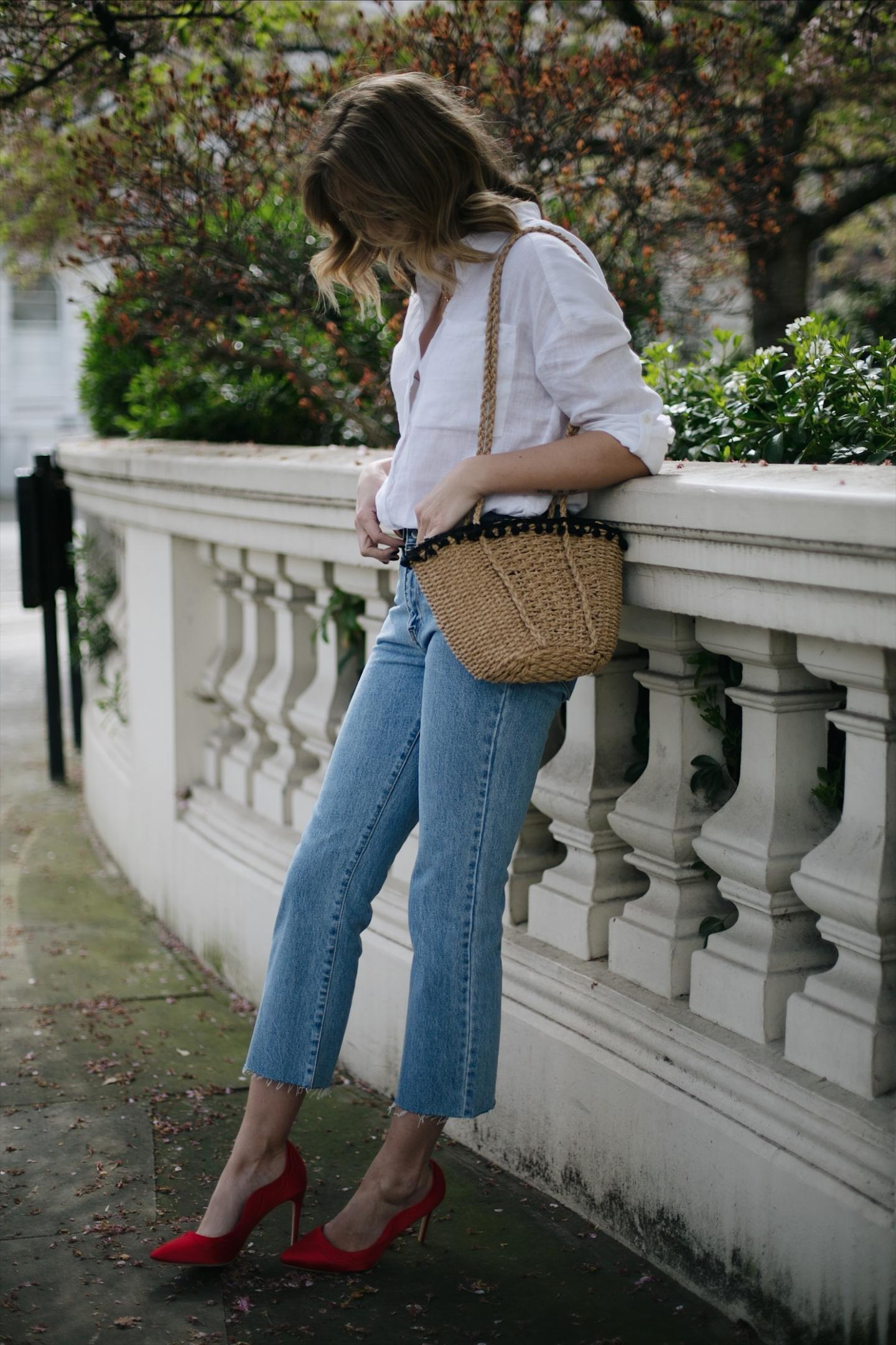 Emma Hill wears Dune loves Rupert Sanderson red 'Princess' heels, light wash cropped jeans, white shirt, straw bag with pom poms