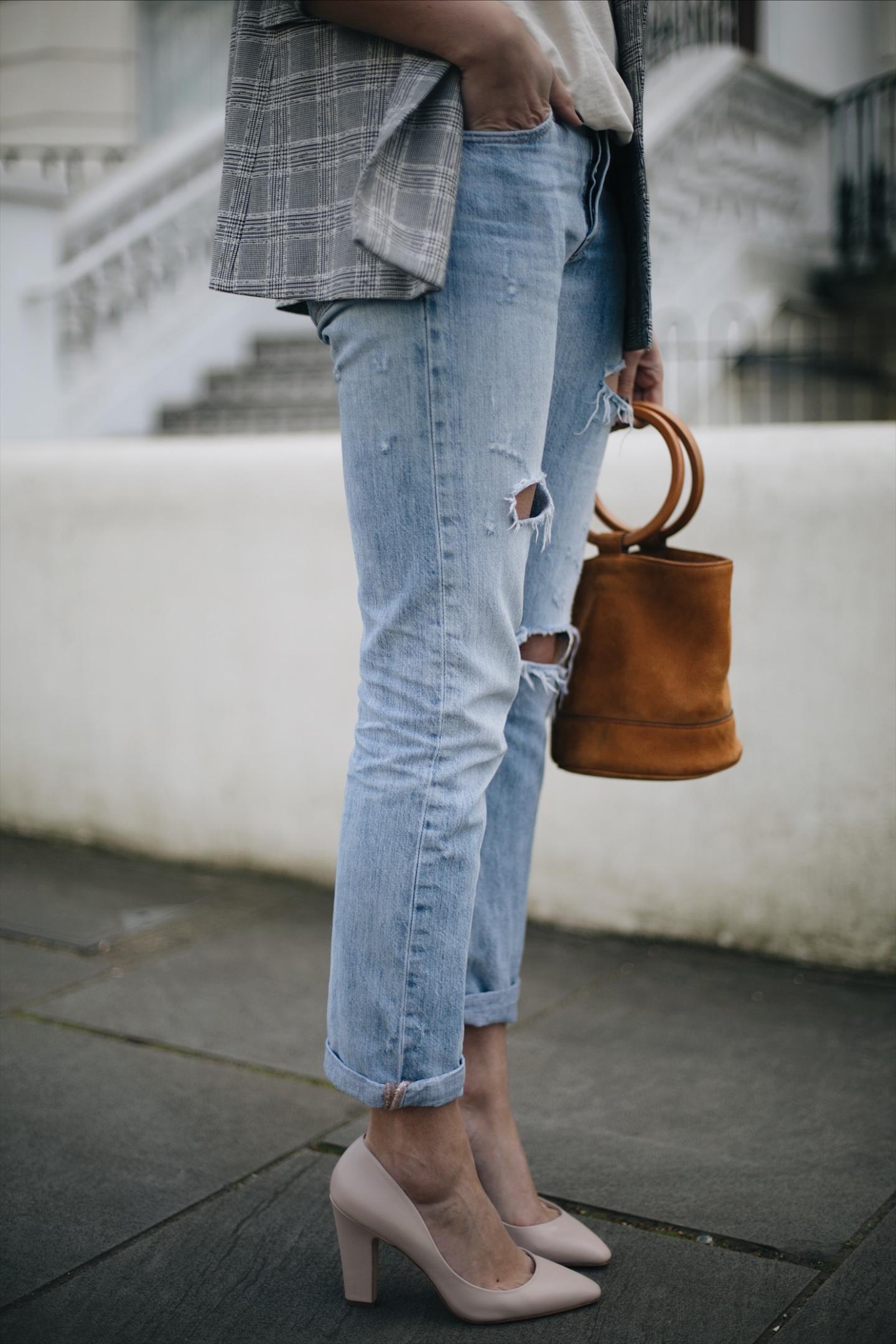 Emma Hill wears Dune x Rupert Sanderson cream leather 'Ella' heels, Levis 501 boyfriend ripped jeans, Isabel Marant Endless t-shirt, check blazer, Simon Miller tan nubuck suede ring handle 'Bonsai' bag