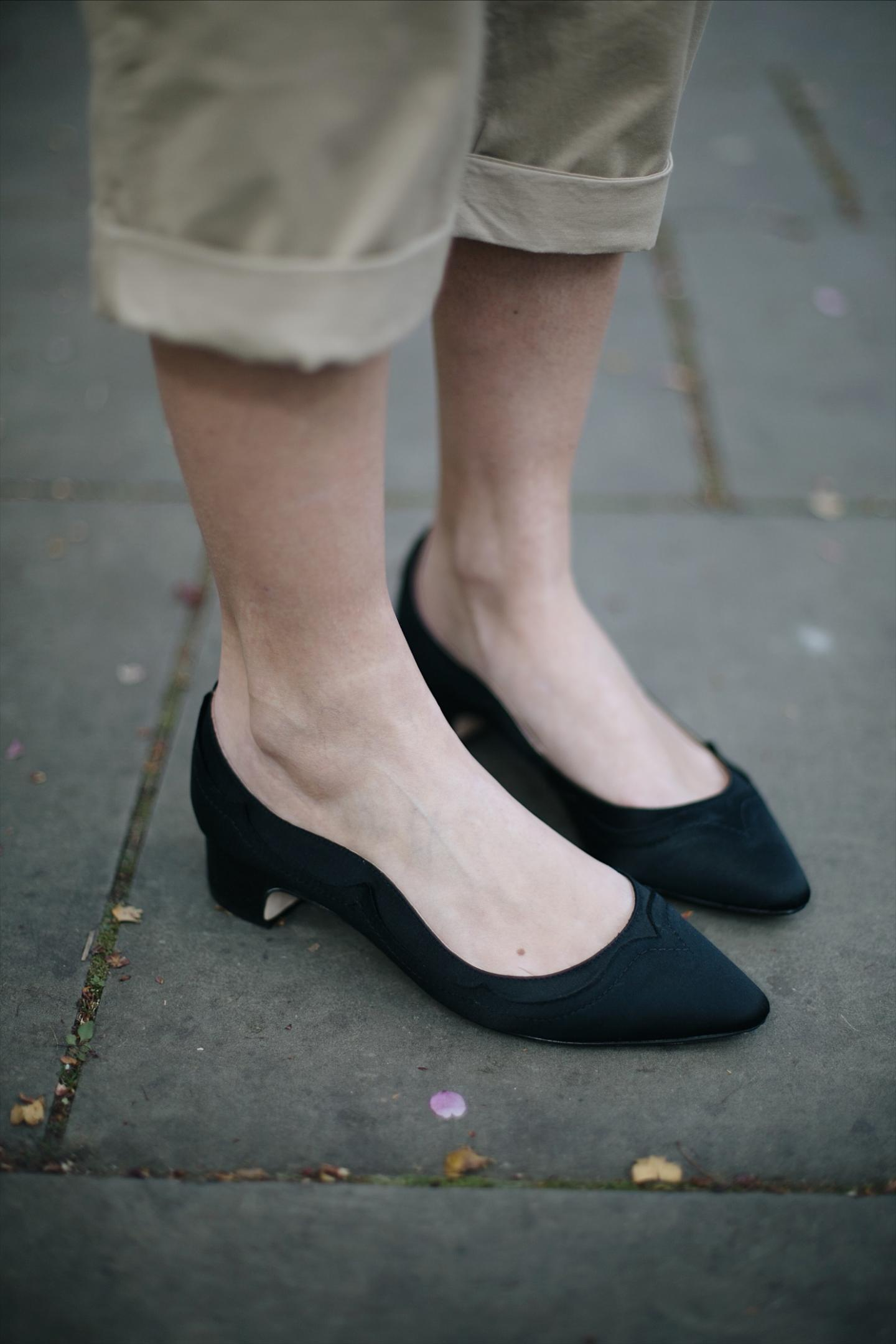 Emma Hill wears Dune x Rupert Sanderson 'Grace Hi' black satin low heels
