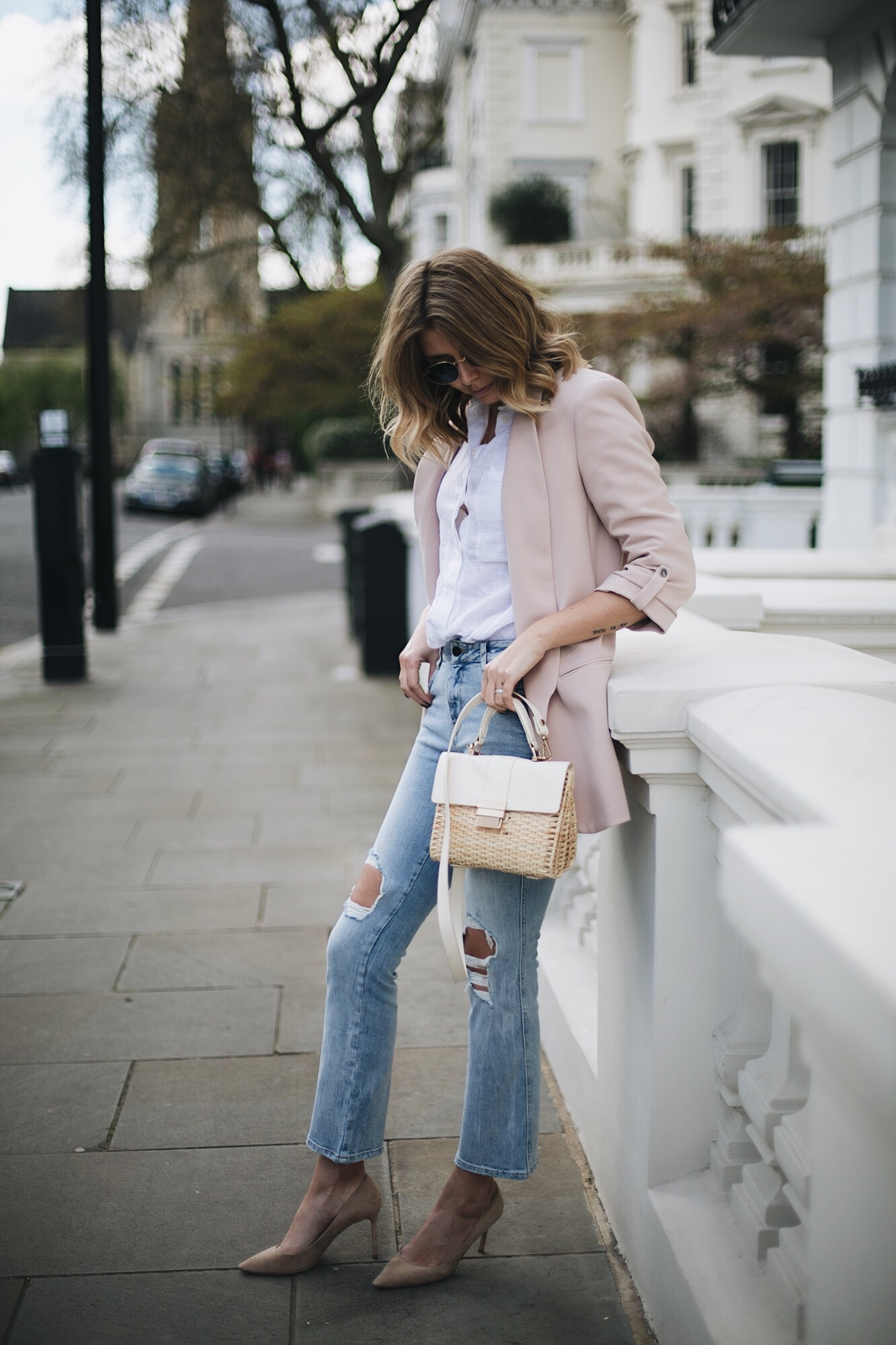 Emma Hill wears nude blazer, white linen shirt, bleach ripped cropped flare jeans, 50's style basket bag, beige suede Jimmy Choo court shoes, chic spring outfit